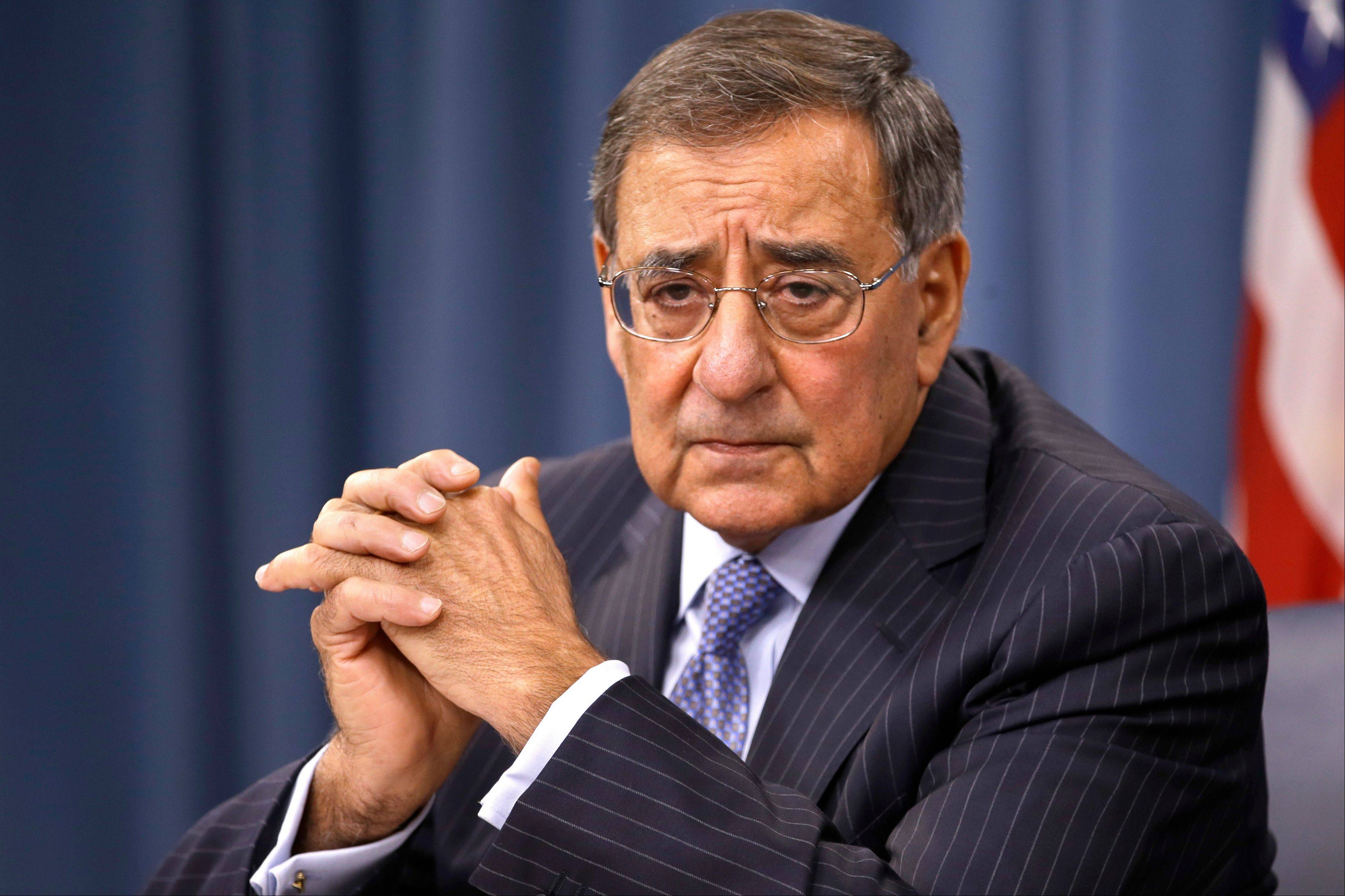 U.S. Defense Secretary Leon Panetta, speaks at a news conference with U.S. Chairman of the Joint Chiefs of Staff Gen. Martin Dempsey, not pictured, at the Pentagon, in Washington.