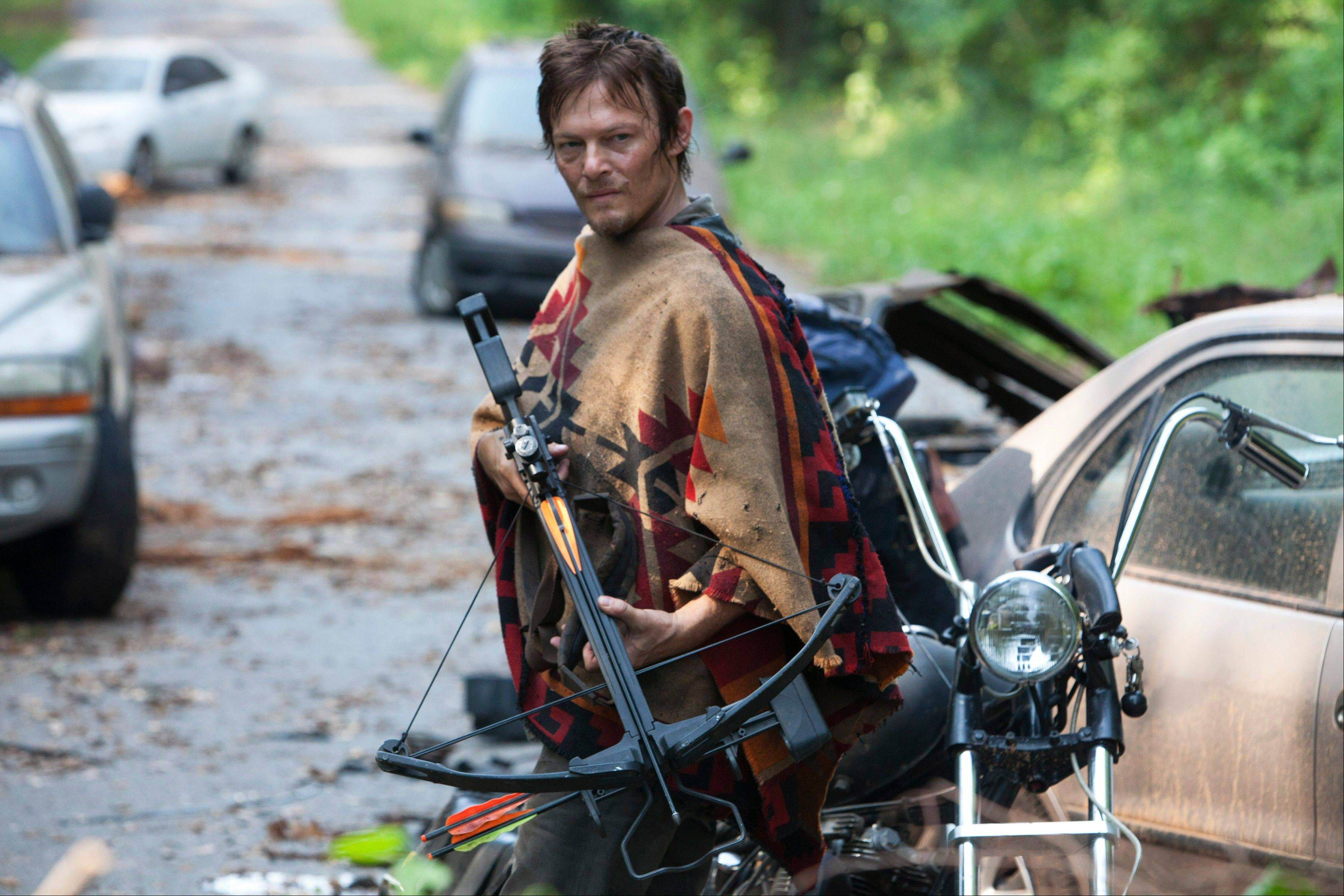 "Daryl Dixon (Norman Reedus) is ready for action in AMC's ""The Walking Dead."" The third season begins at 8 p.m. Sunday on AMC."