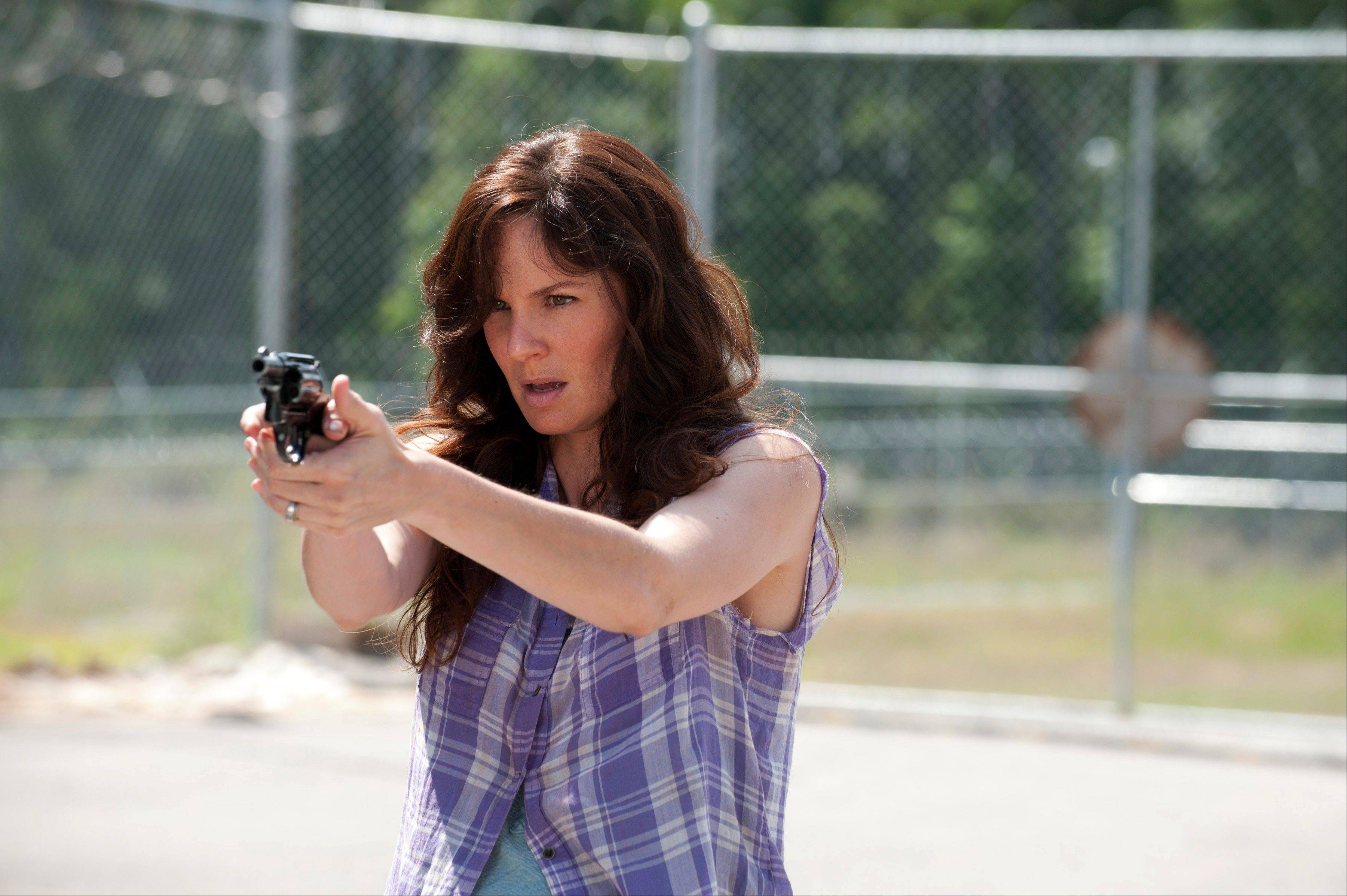 "Watch out! Lori's (Sarah Wayne Callies) armed! AMC's hit zombie survival tale, ""The Walking Dead,"" returns Sundays at 8 p.m."