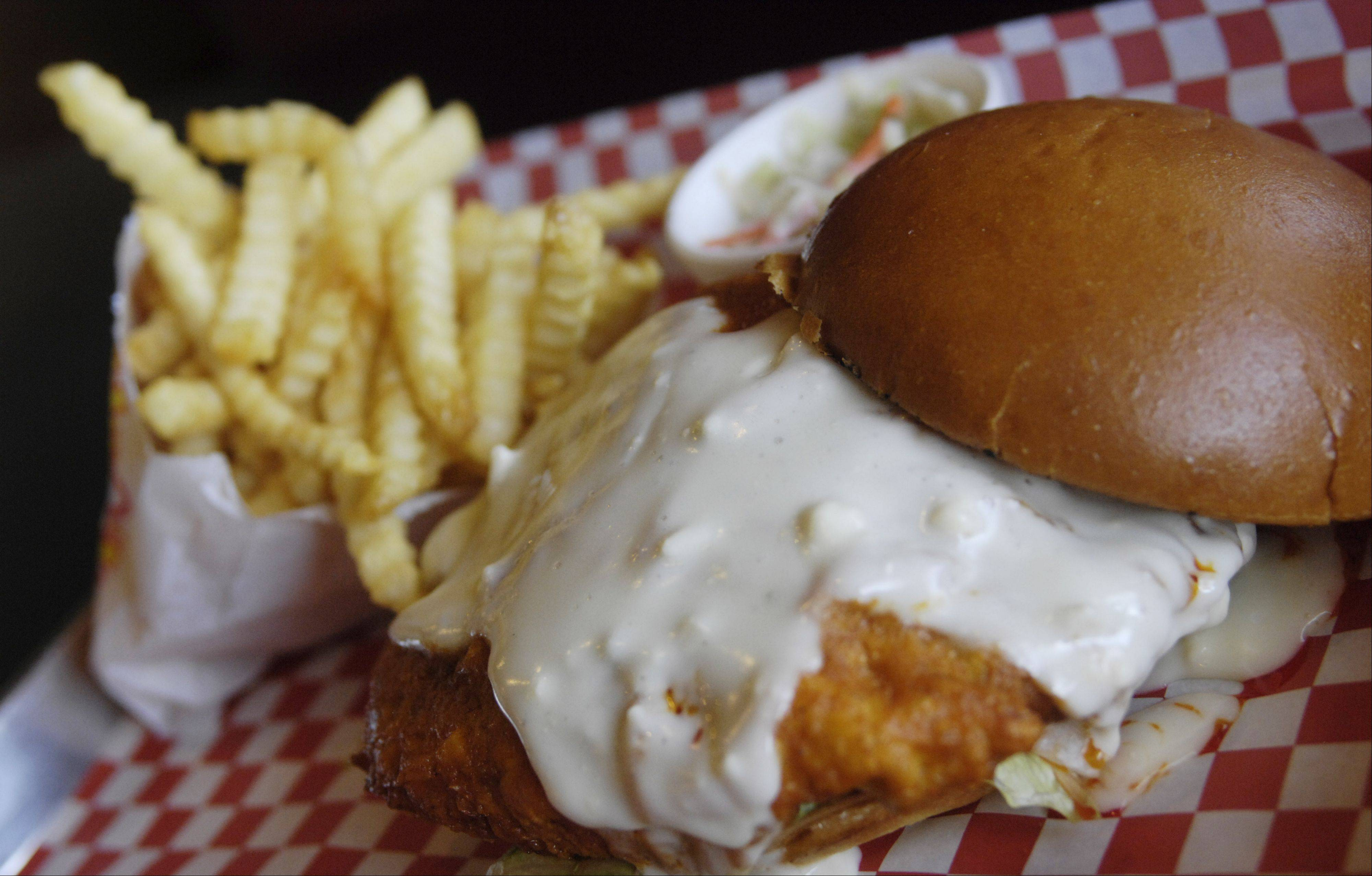 A buffalo-style chicken sandwich is on the menu at JD's Q & Brew in Arlington Heights.