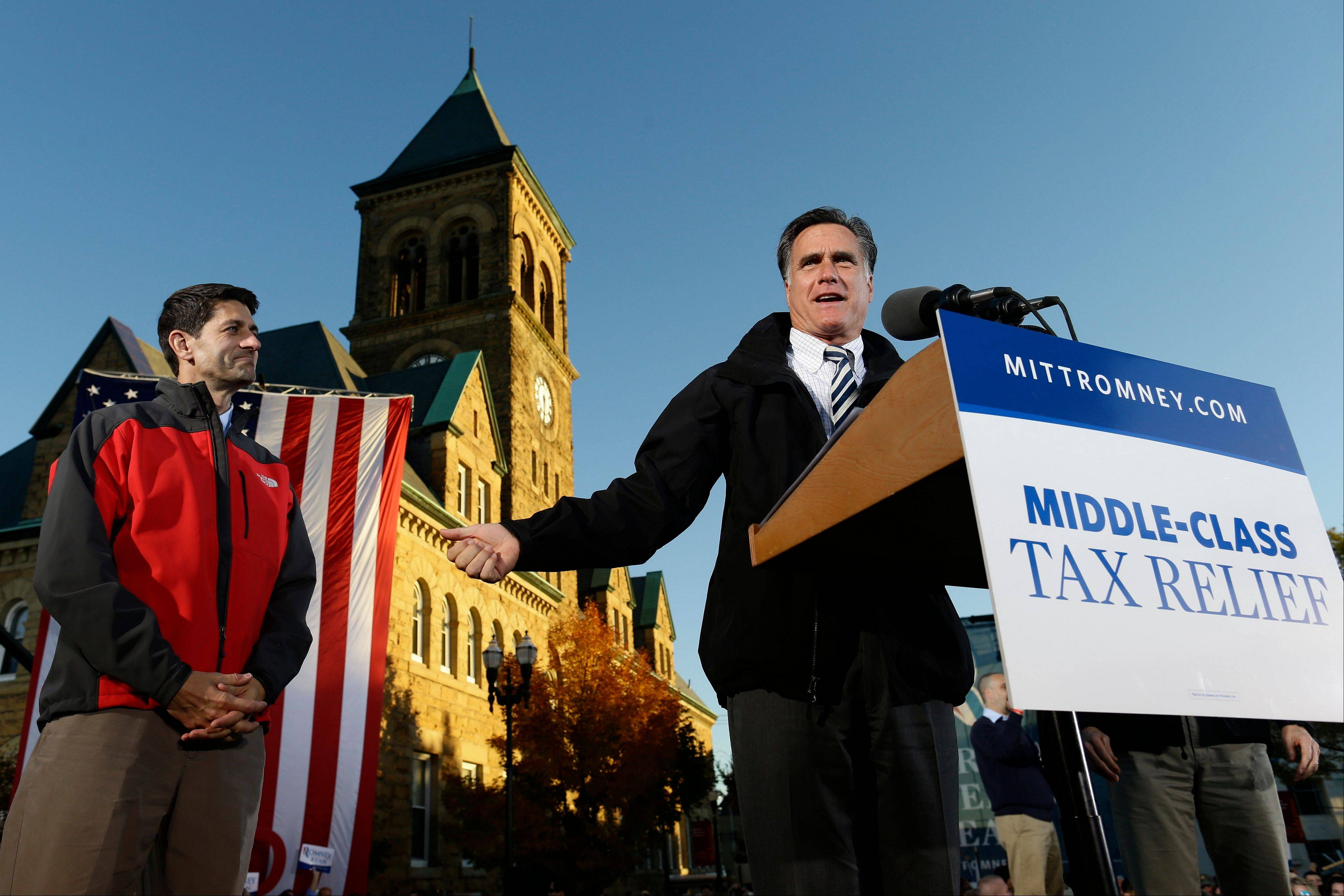 Republican presidential candidate and former Massachusetts Gov. Mitt Romney, right, and Republican vice presidential candidate, Rep. Paul Ryan, a Wisconsin Republican, campaign Friday in Lancaster, Ohio.