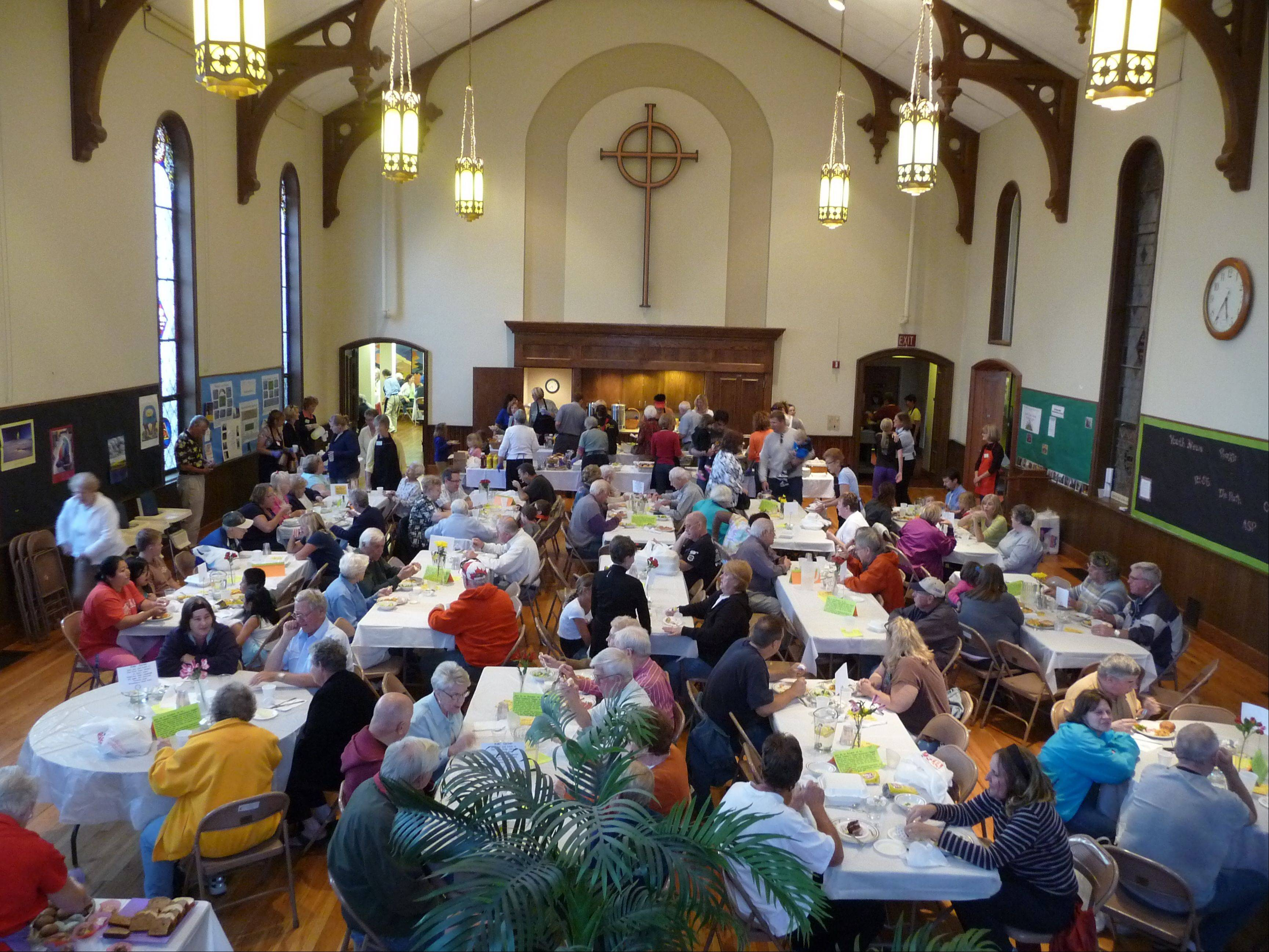 Diners enjoy the meal in the dining room at the Geneva United Methodist Church.