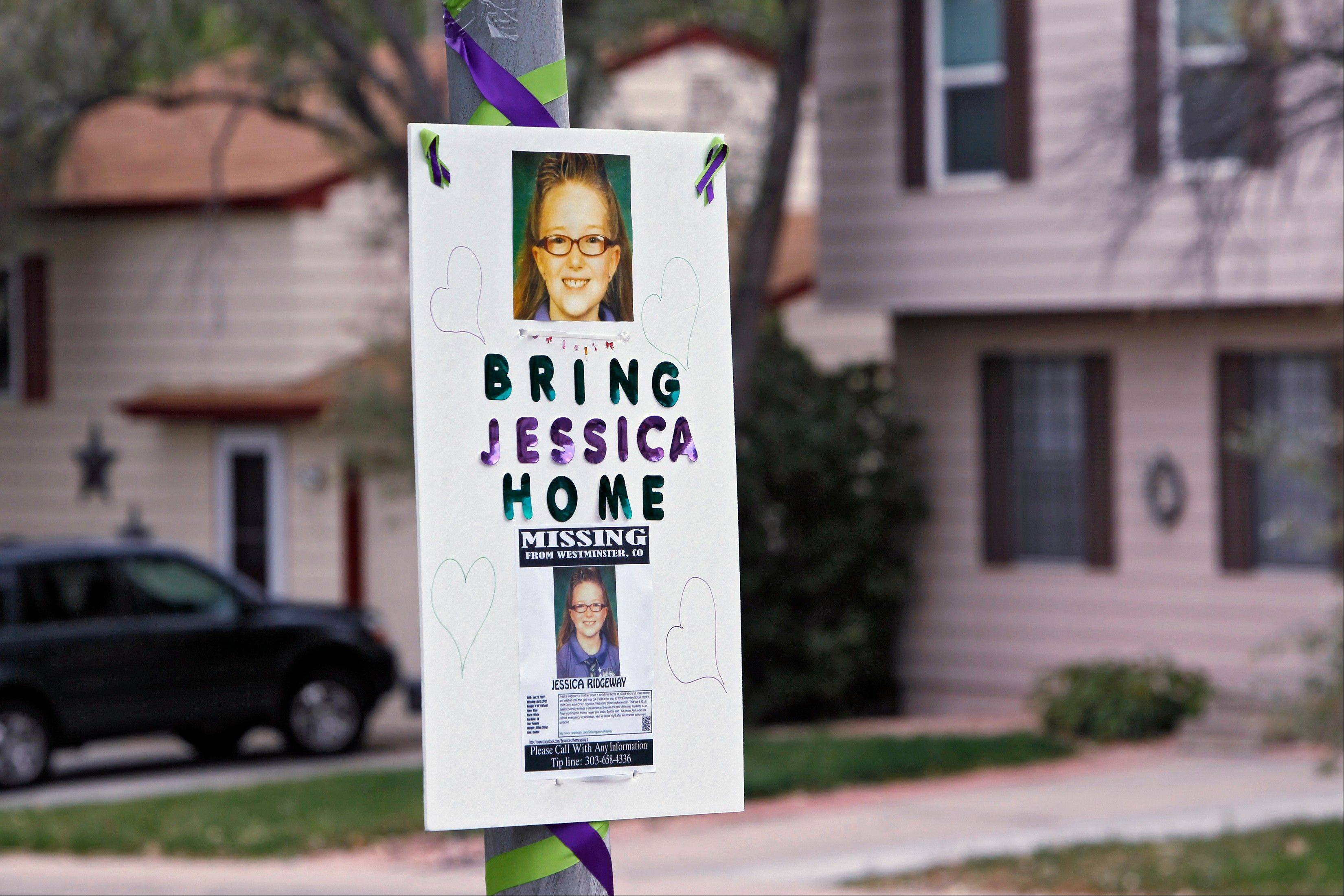A missing person sign is posted on a lamp post near the home of ten-year-old Jessica Ridgeway where police continue to search for the missing girl in Westminster, Colo., on Wednesday, Oct. 10, 2012. The youngster has been missing since she left her home Oct. 5 on her way to school.