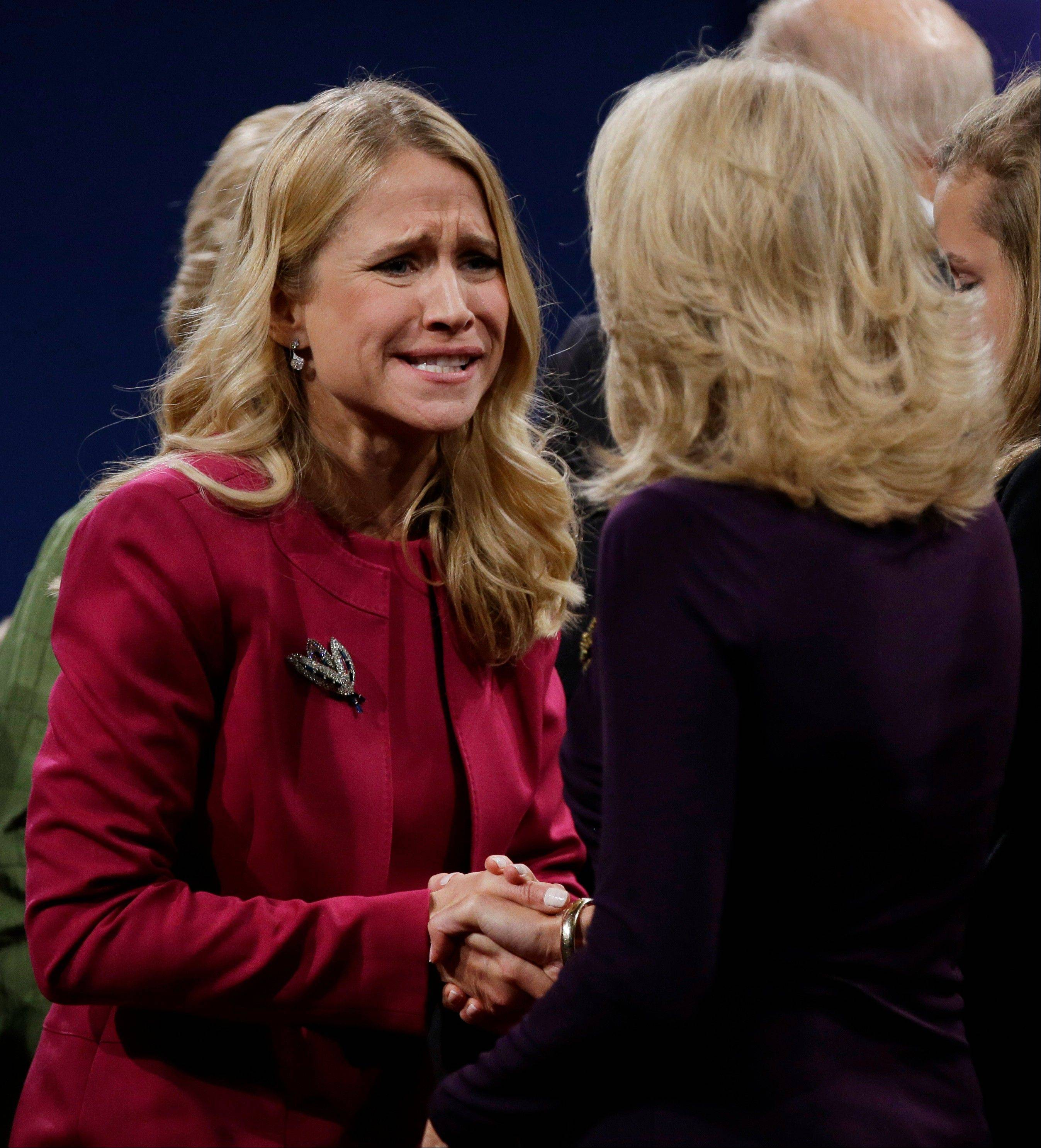 Republican vice presidential nominee Rep. Paul Ryan's wife Janna, left, shakes hands with Jill Biden, wife of Vice President Joe Biden, following the vice presidential debate at Centre College in Danville, Ky.