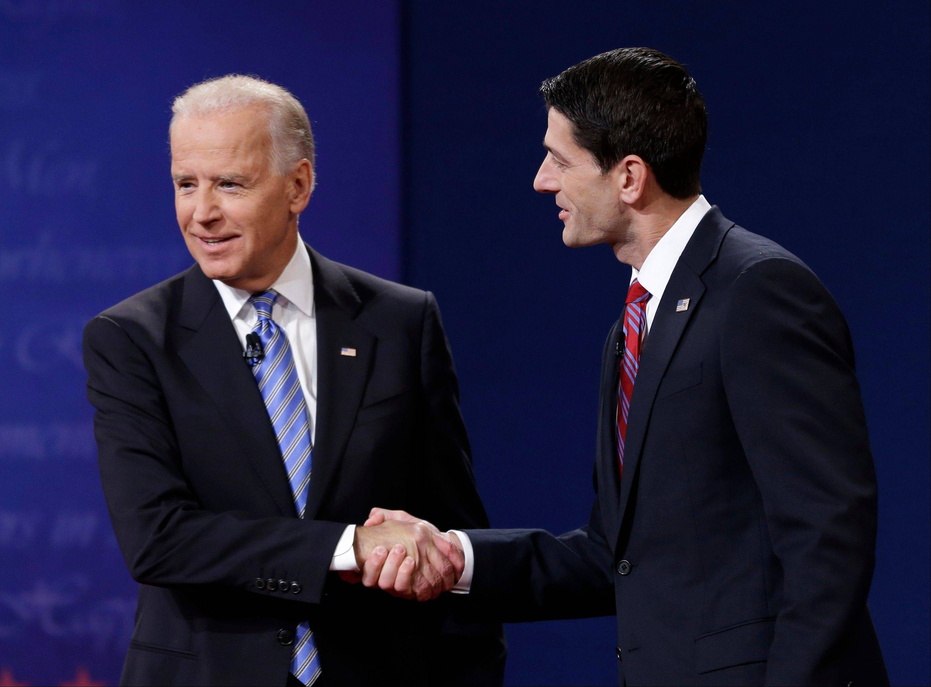 Vice President Joe Biden, left, and Republican vice presidential nominee Paul Ryan of Wisconsin shake hands during the vice presidential debate at Centre College.