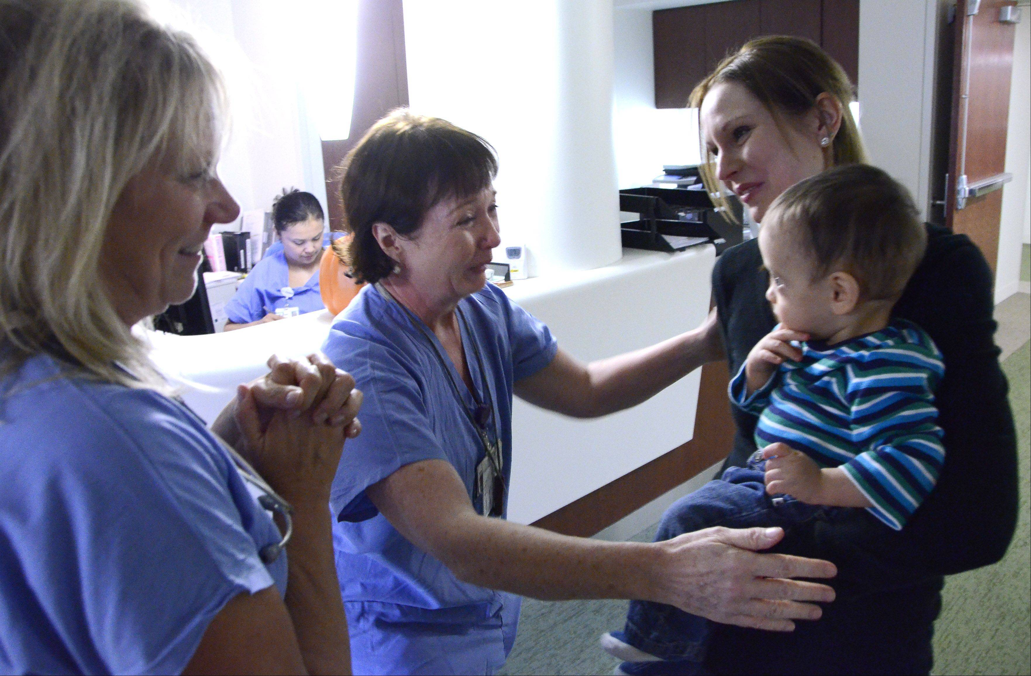 Nurses Murlene Mastandrea, left, and Irene Wysocki were reunited Thursday with Brynn Kordik of West Dundee and her nearly year-old son, Zachary.