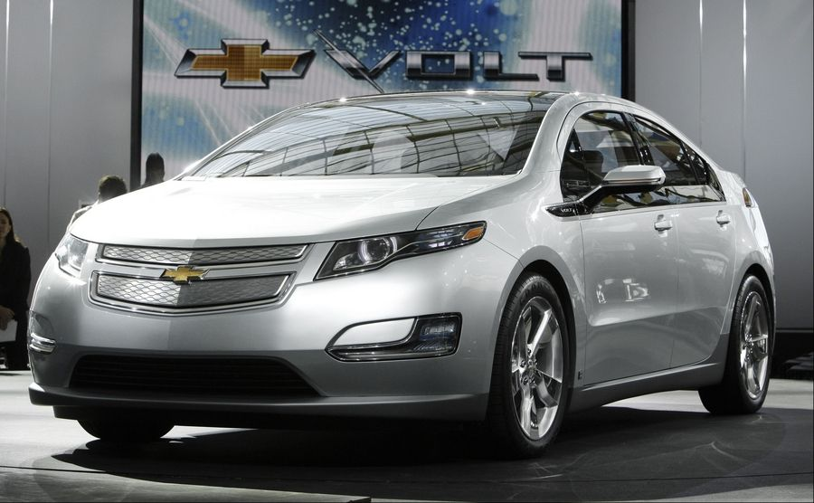 Naperville officials will flip the switch on the city's first public station, in the downtown Van Buren Street parking lot, at 9:30 a.m. Tuesday where owners can charge their electric cars like this Chevy Volt.