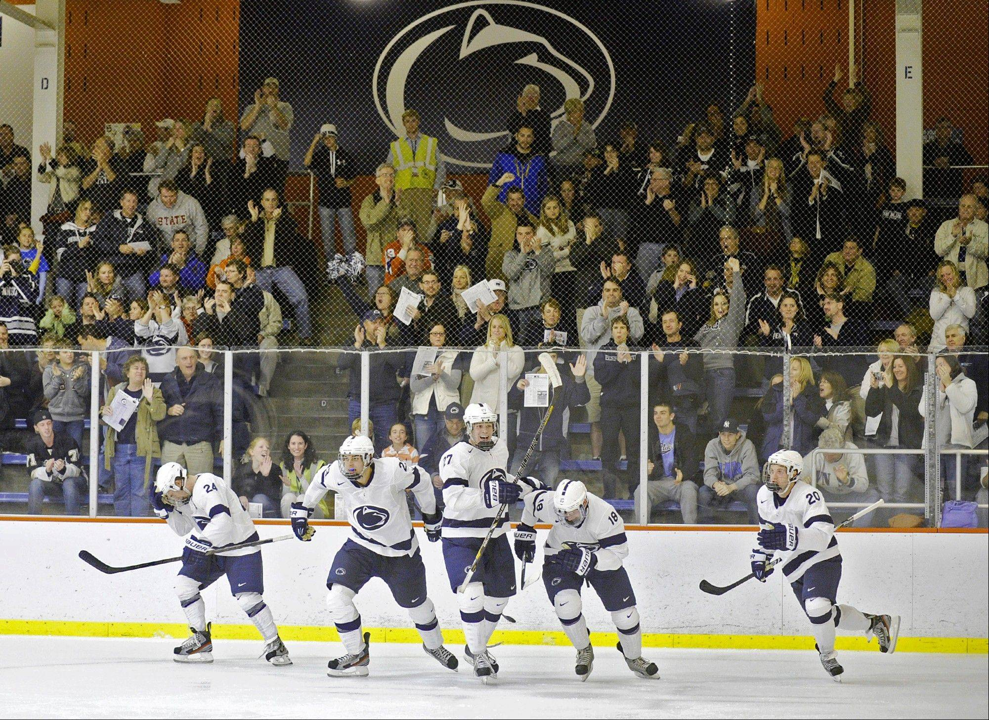 Penn State players celebrate their first goal of the game against American International College don Friday at Greenberg Ice Pavilion in State College, Pa.