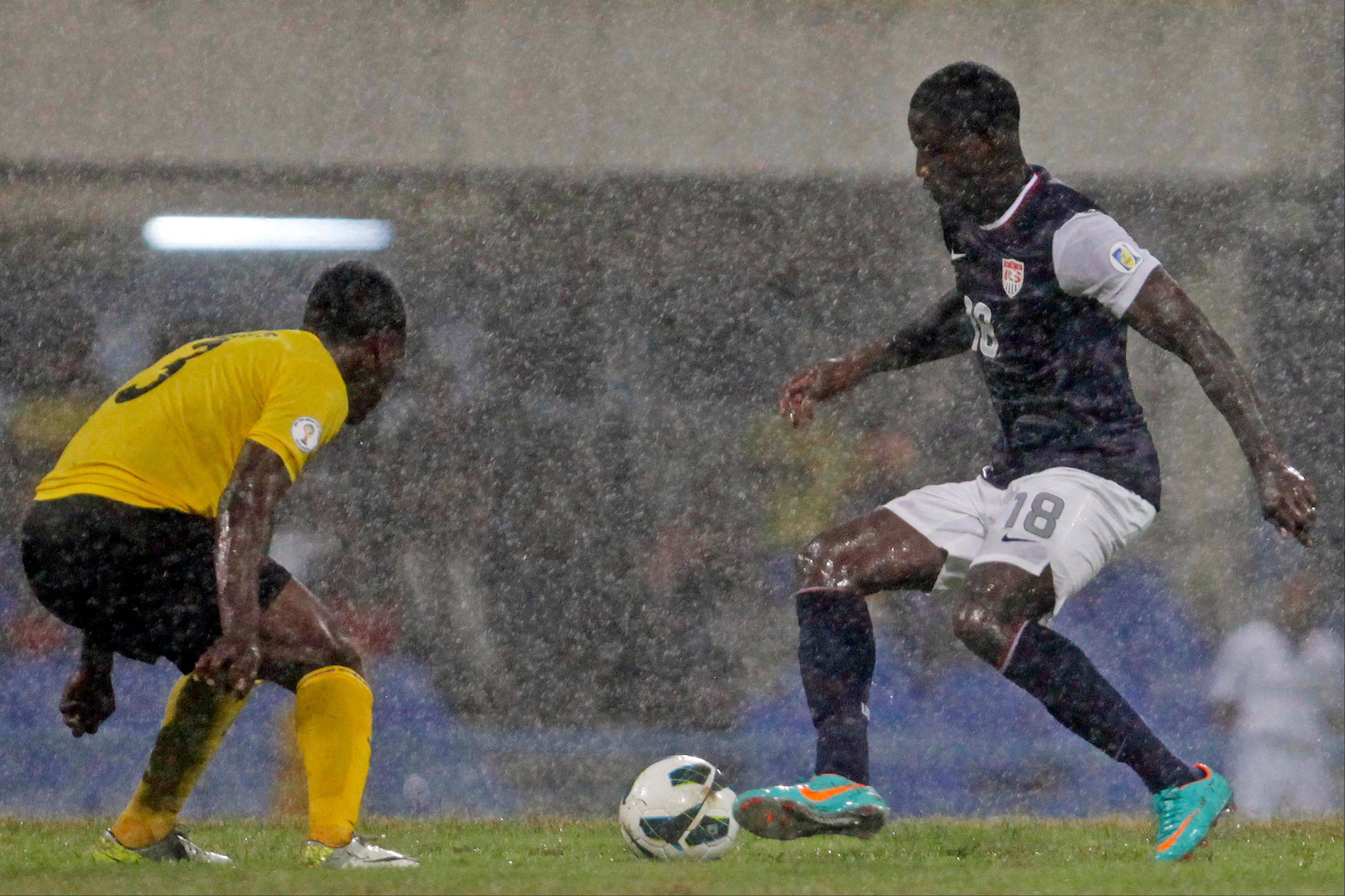 U.S. national team player Eddie Johnson, right, challenges Antigua and Barbuda's Zaine Sebastian Francis-Angol Friday during a 2014 World Cup qualifying soccer match in St. John, Antigua and Barbuda.