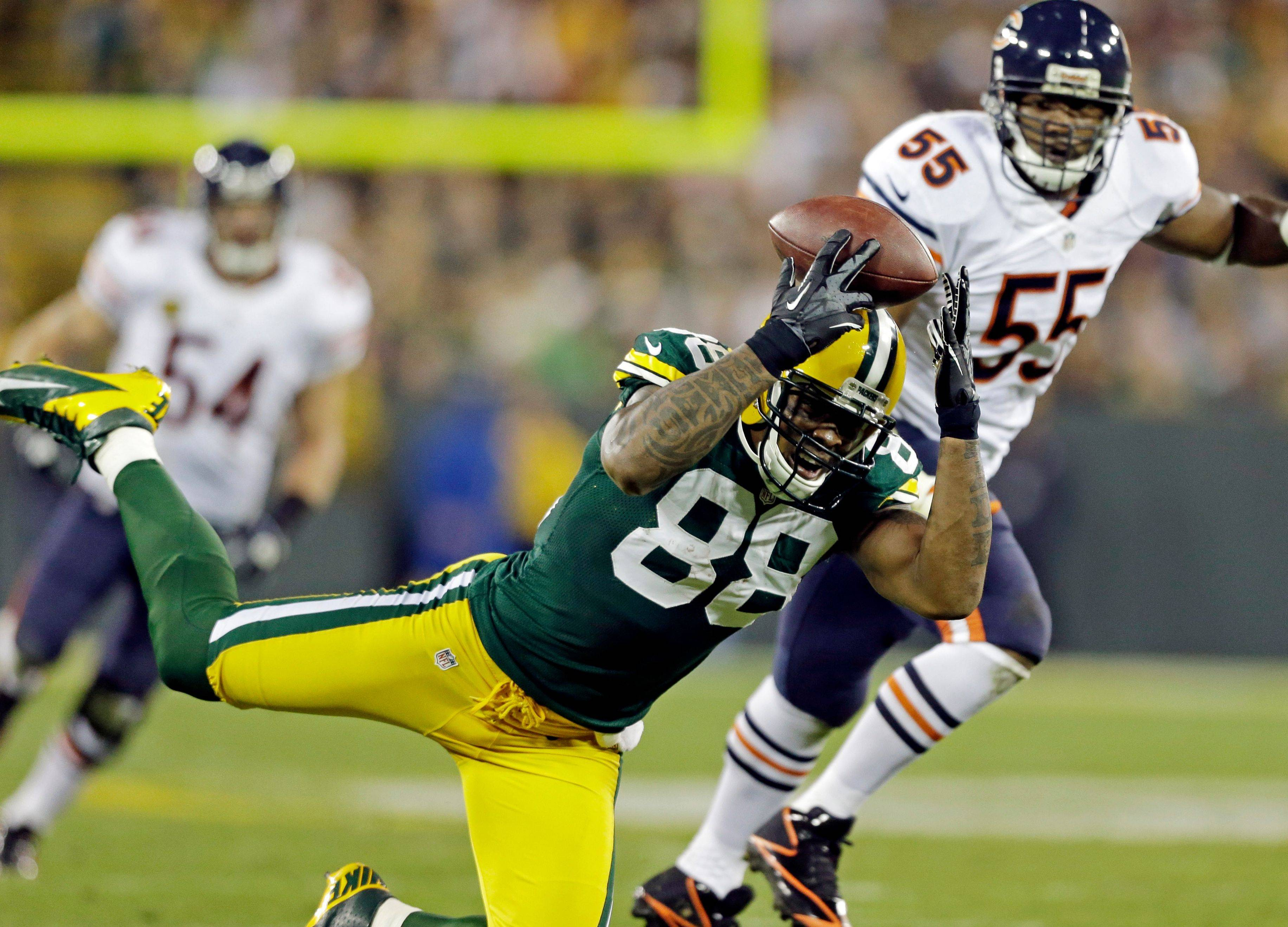 Jermichael Finley can't catch a pass in front of Lance Briggs during their game earlier this year. Finley has been killing fantasy owners this season as he has just 198 yards receiving and 1 TD.