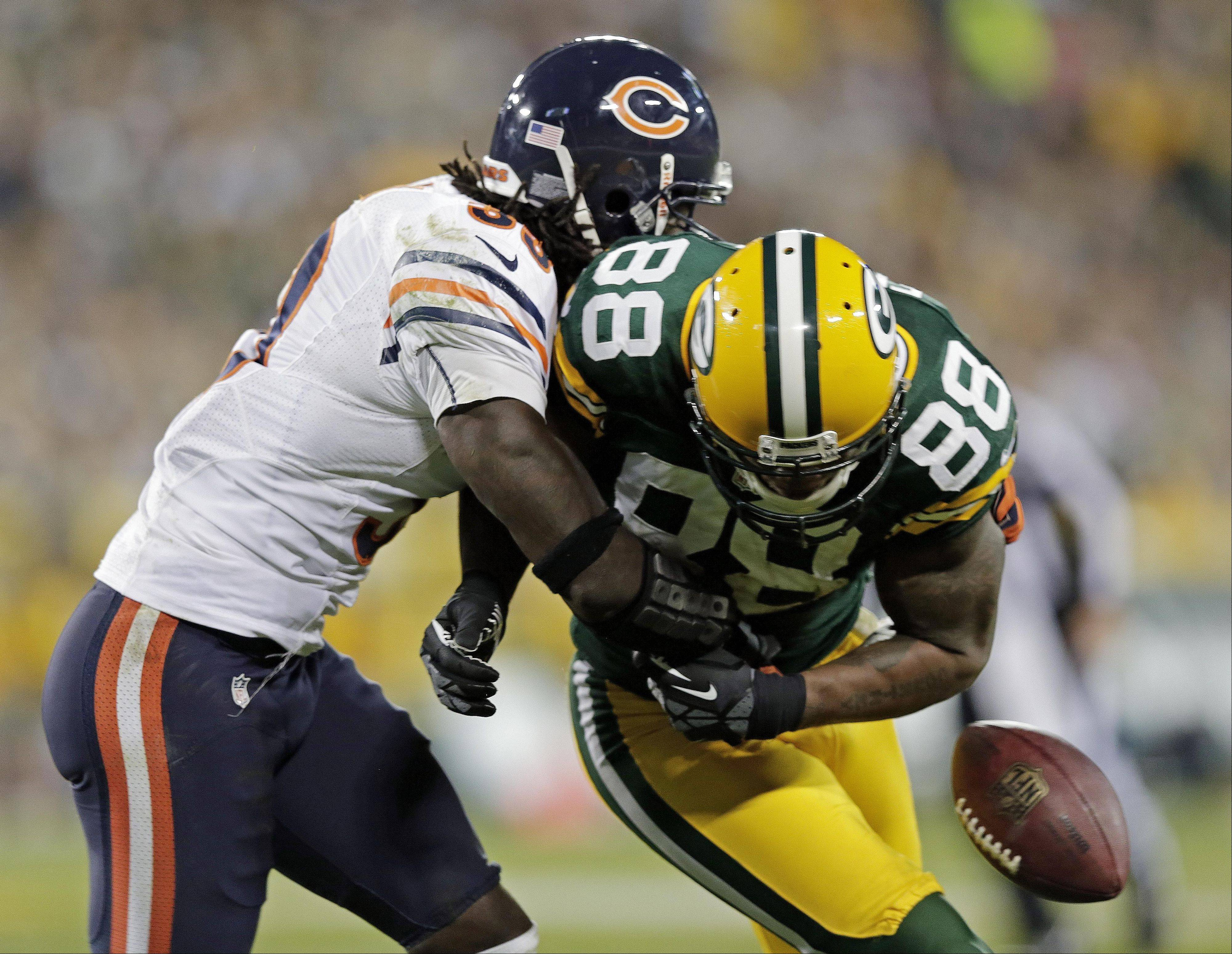 Green Bay Packers' Jermichael Finley (88) fumbles as he is hit by Chicago Bears' Charles Tillman (33) during the second half of an NFL football game Thursday, Sept. 13, 2012, in Green Bay, Wis. The Bears recovered the fumble.