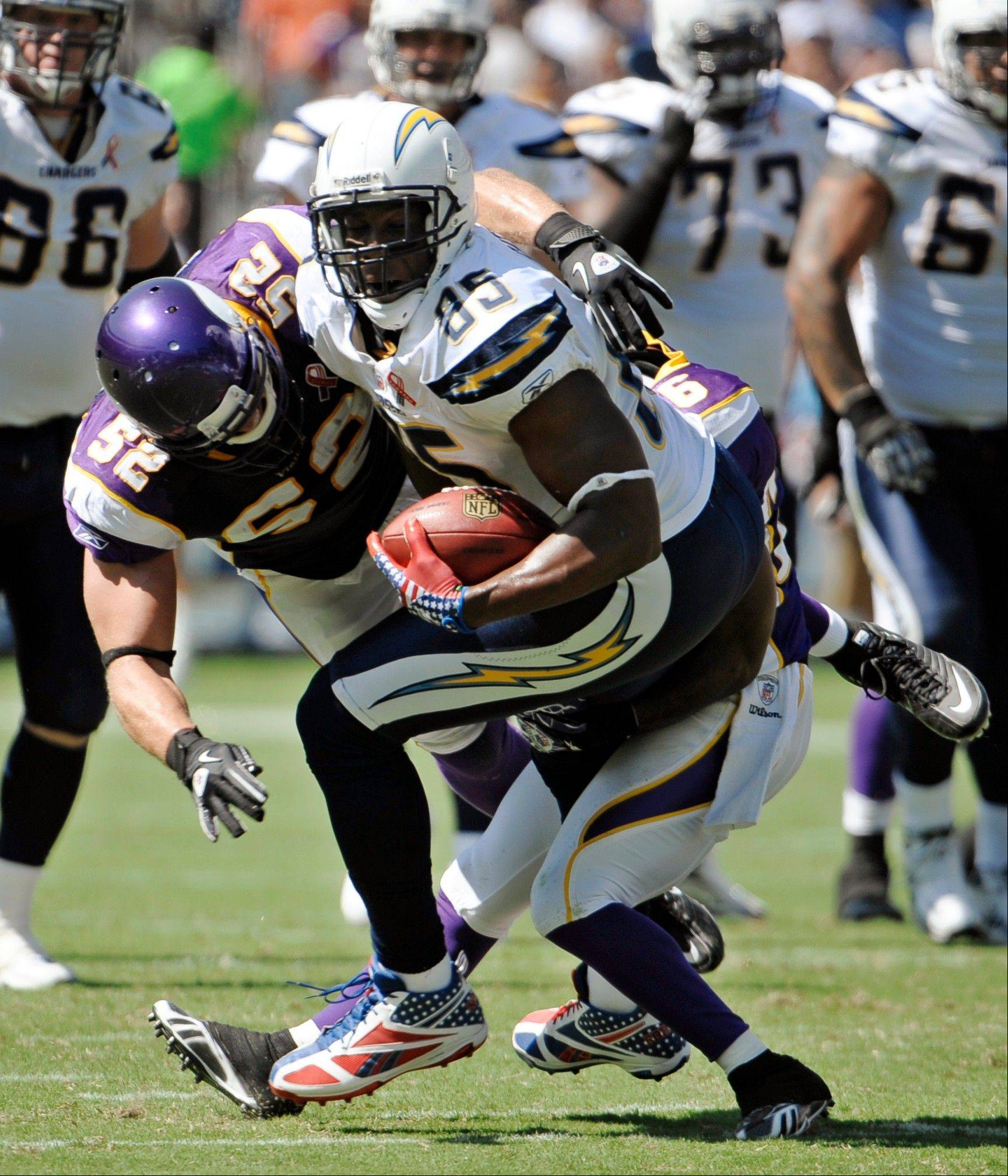 Minnesota Vikings linebacker Chad Greenway stops San Diego Chargers tight end Antonio Gates during the first half of a NFL football game Sunday, Sept. 11, 2011, in San Diego.