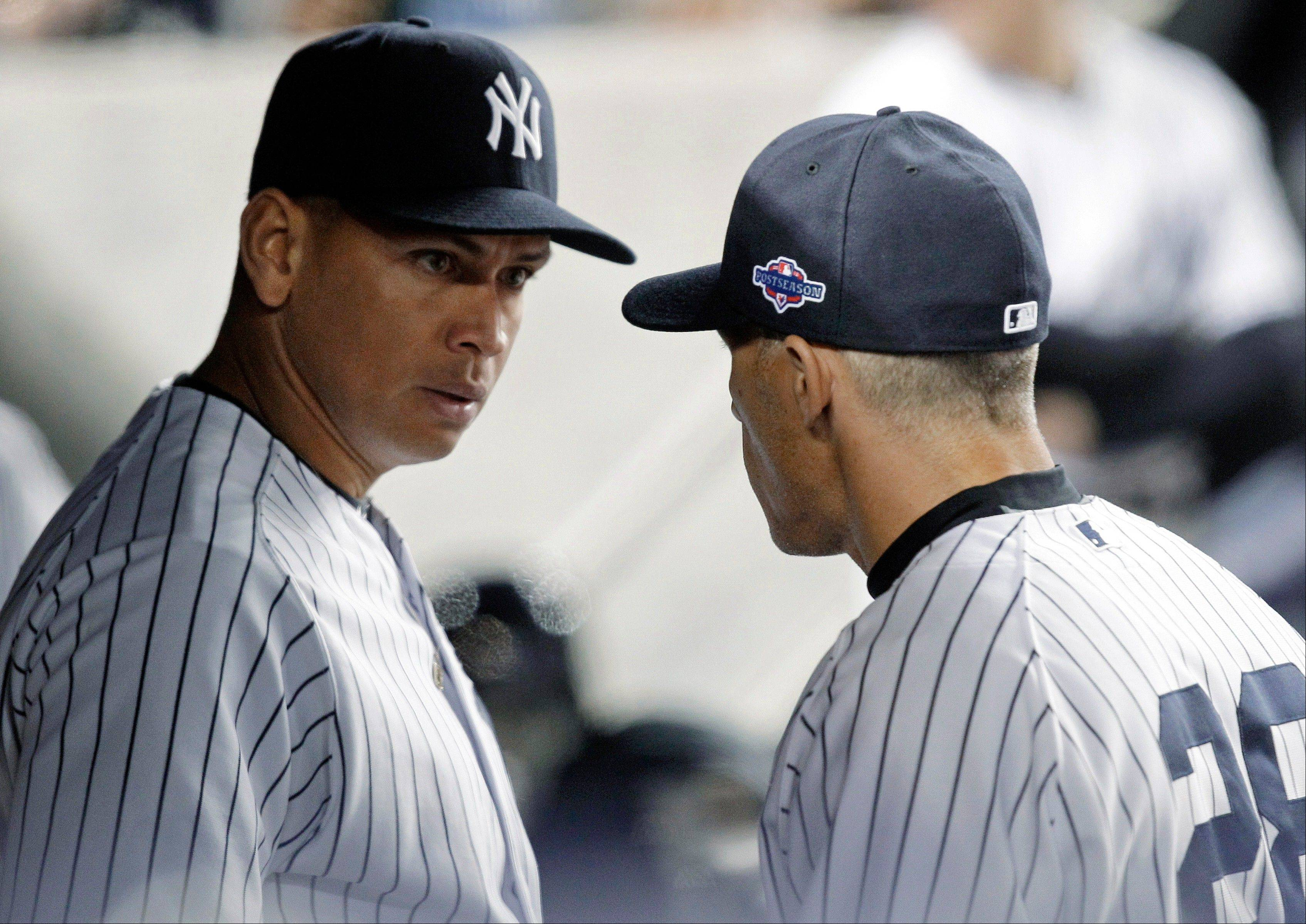 Alex Rodriguez, left, talks to New York Yankees manager Joe Girardi during Wednesday's game against Baltimore. Raul Ibanez pinch hit for the struggling Rodriguez and won the game for the Yankees.