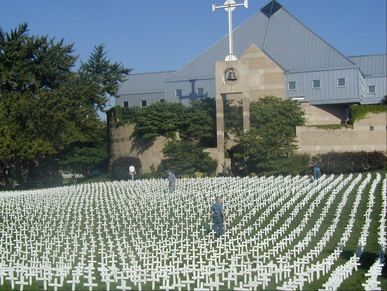 As part of the Respect Life Month, parishioners from St. Peter Church in Geneva put 3,500 crosses on the church lawn.