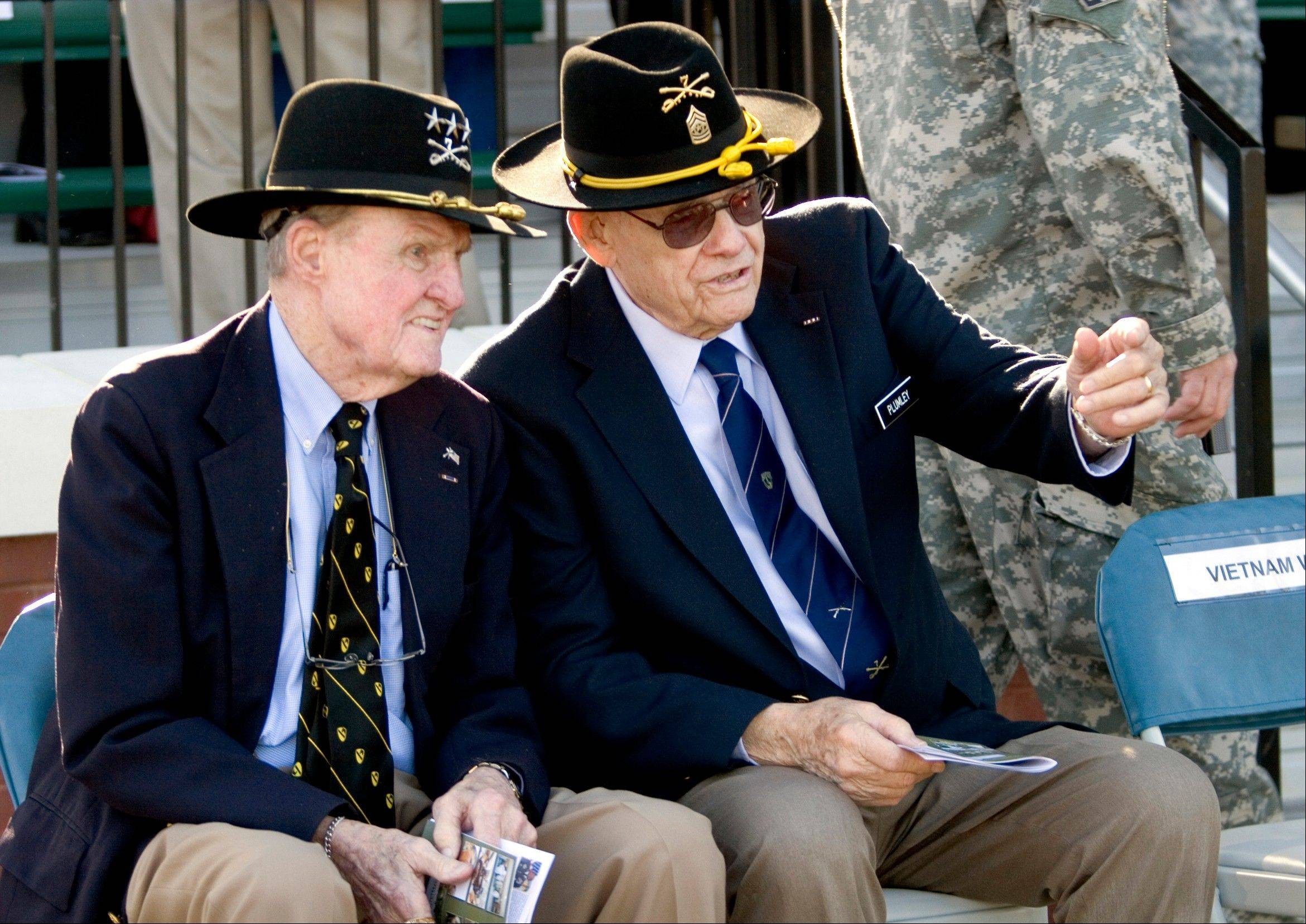 In a March 19, 2009 photo, retired Command Sgt. Maj. Basil L. Plumley, right, and retired Lt. Gen. Hal Moore, left, who served together with the 1st Cavalry Division in the Ia Drang Valley, talk at the National Infantry Museum and Soldier Center in Columbus, Ga. Plumley, 92, died Wednesday morning at the Columbus Hospice in Columbus, Ga.