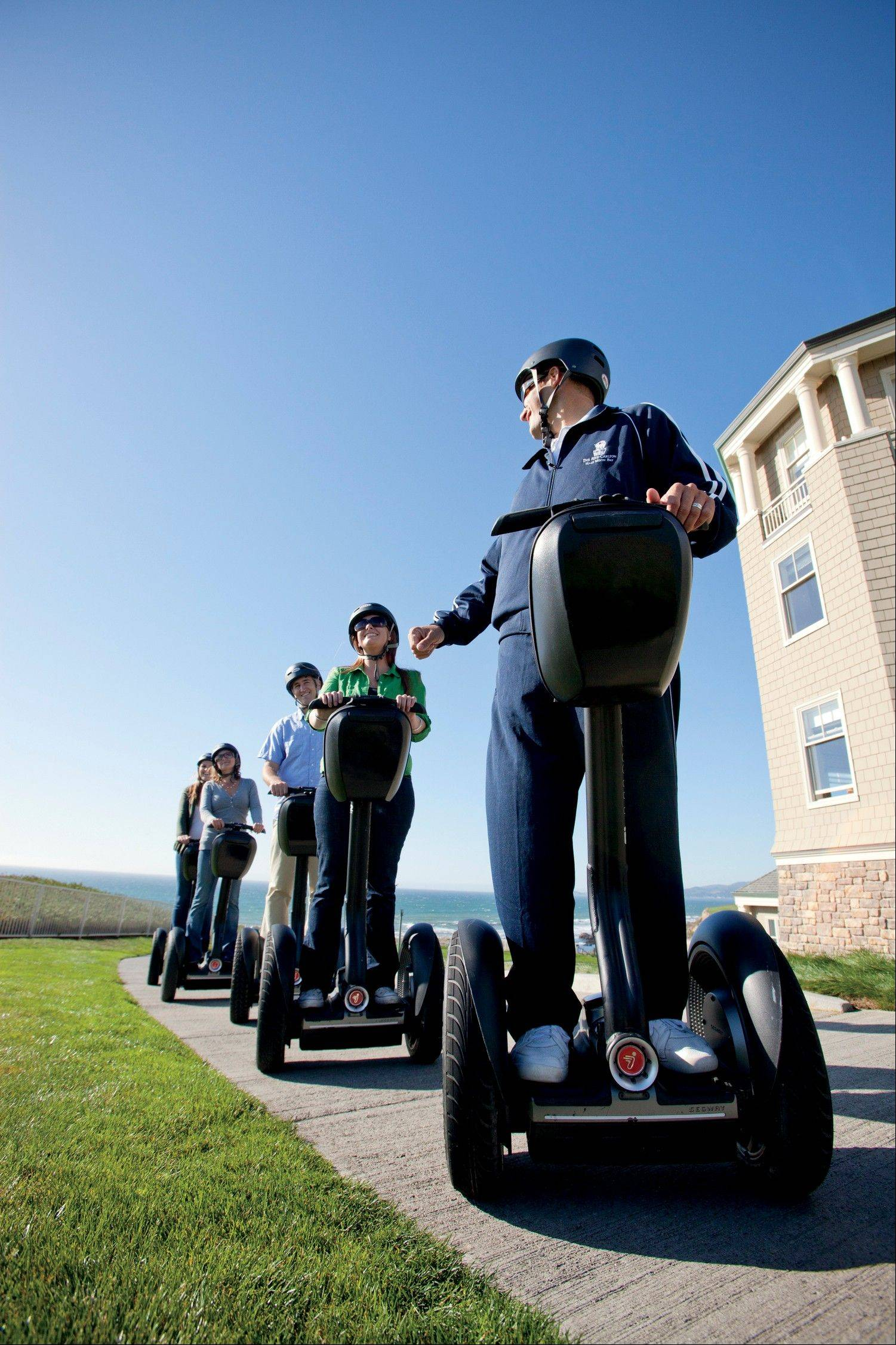 A recreational staff member lead a group of hotel guests on a Segway tour of the Coastal Trail in Half-Moon Bay, Calif., on the Pacific Ocean. A number of hotels offer Segway tours as a novel way to see their grounds and nearby scenic areas.