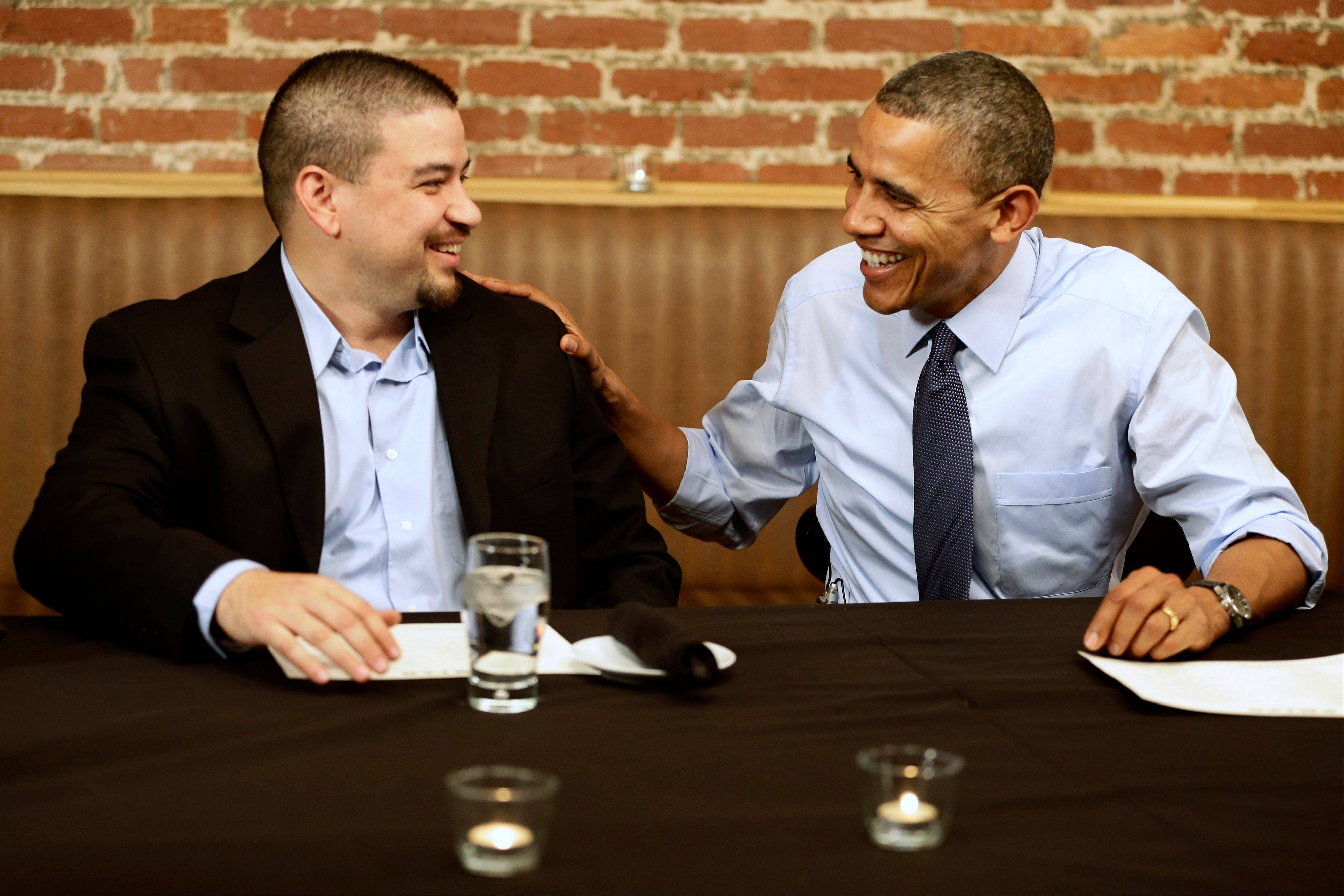 President Barack Obama meets with Mario Orosa, left, of North Canton, Ohio, and other winners of the �Dinner With Barack� campaign fundraising contest Friday at Smith Commons Dining Room and Public House in Washington.