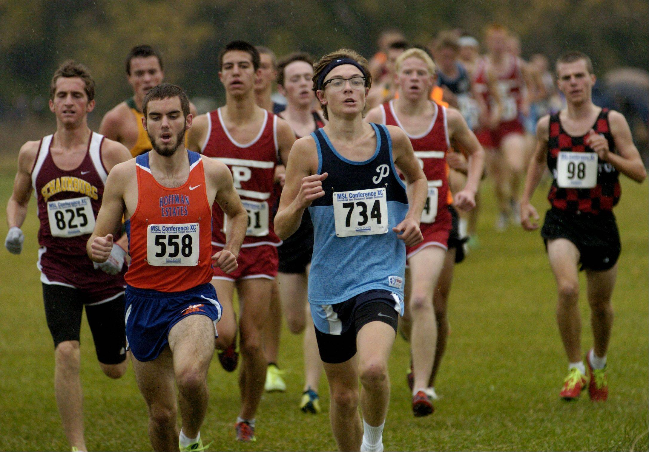 Quentin Shaffer of Prospect leads the field on the first lap of the Mid-Suburban League boys cross country championship at Busse Woods.