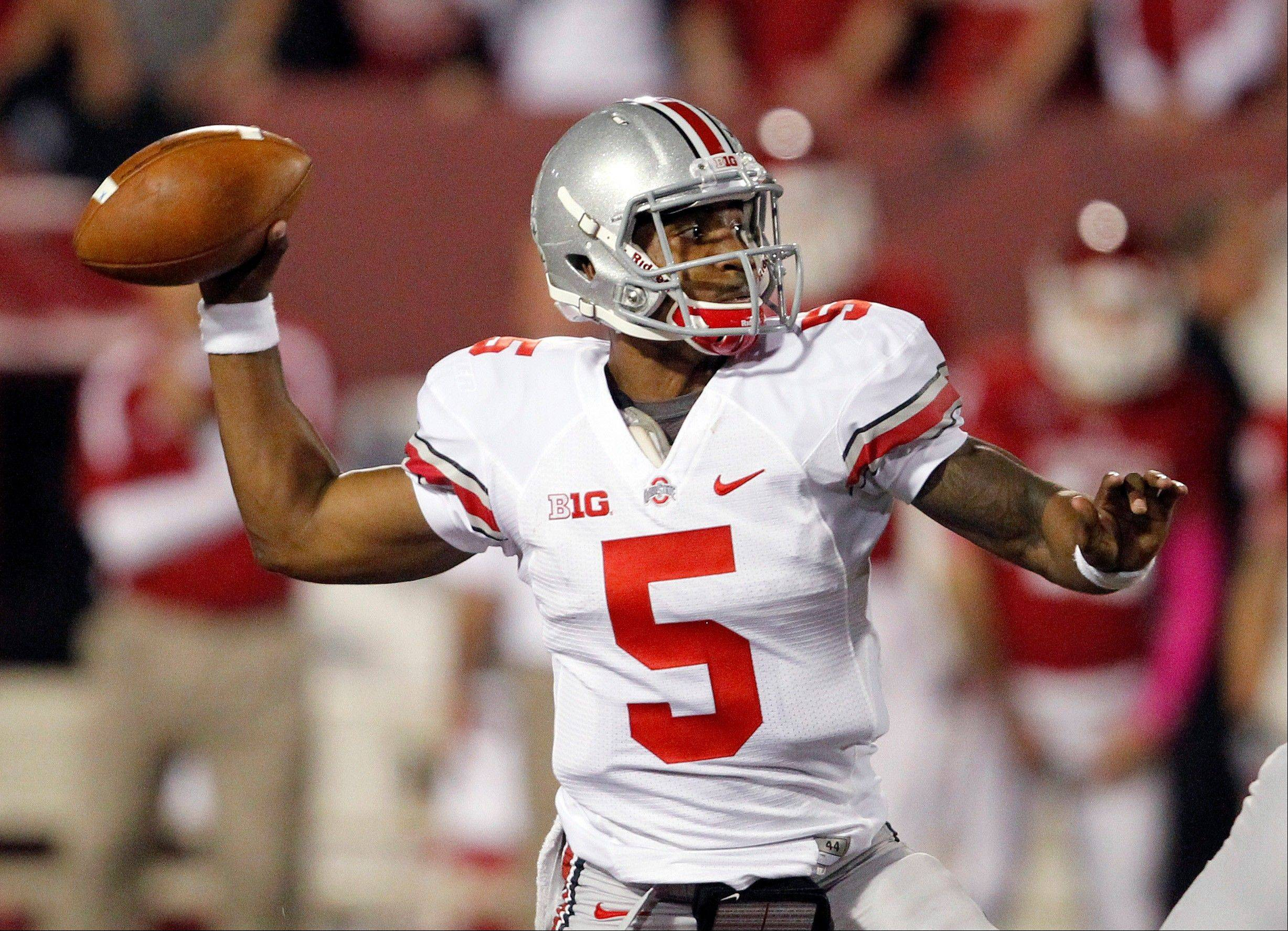 Ohio State quarterback Braxton Miller throws during the first half against Indiana in an NCAA college football game in Bloomington, Ind., Saturday, Oct. 13, 2012. (AP Photo/Sam Riche)