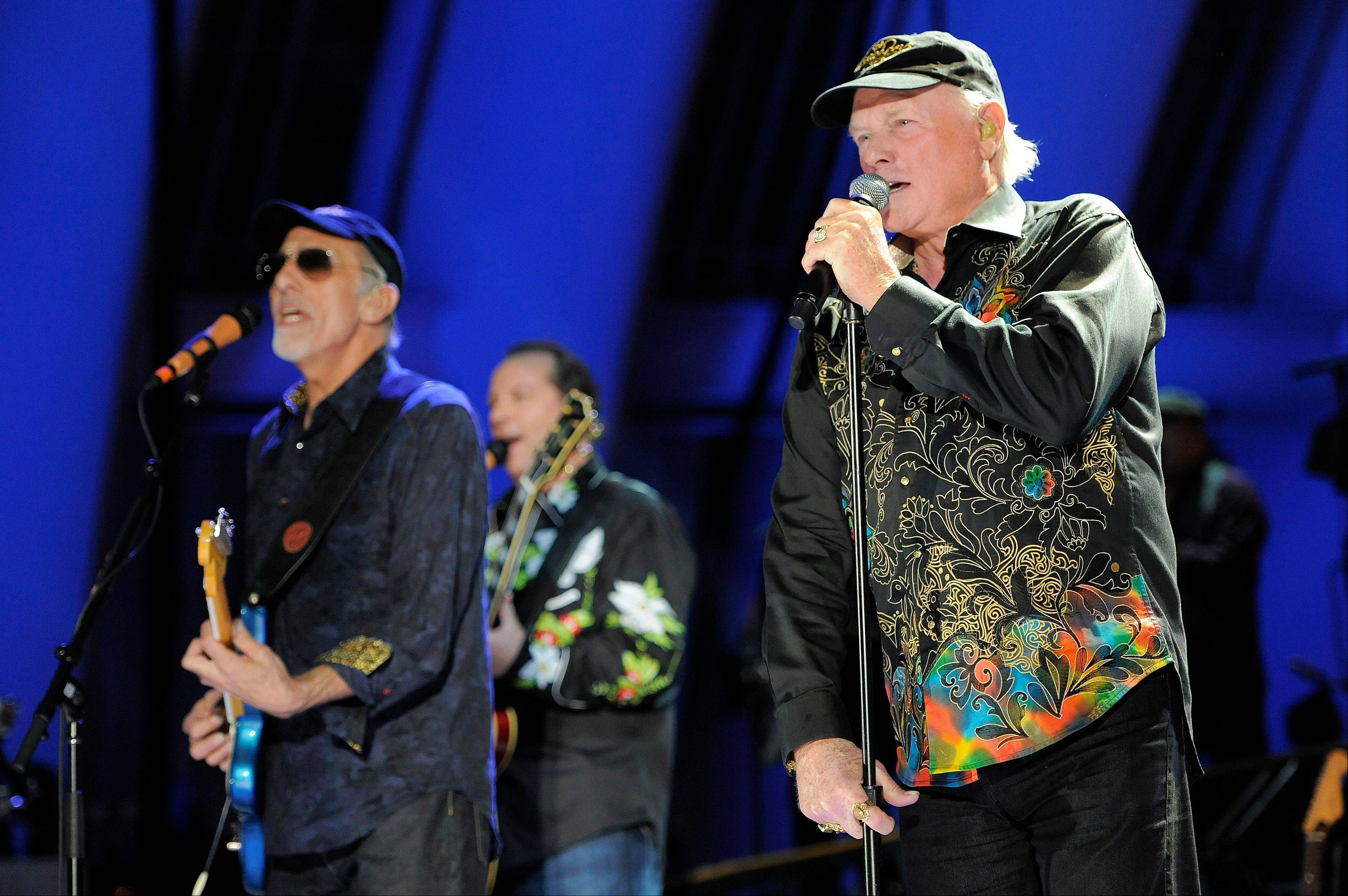 In this June 2, 2012 file photo, Mike Love, right, of The Beach Boys, performs alongside fellow band member David Marks at the Hollywood Bowl in Los Angeles. Brian Wilson says he felt blindsided by a news release from his Beach Boys bandmate Mike Love that ended the good vibrations on the band's 50th anniversary tour. Wilson says the expectation was that both sides would help craft and approve the news release. That didn't happen and now he thinks it's Love's turn to reach out.