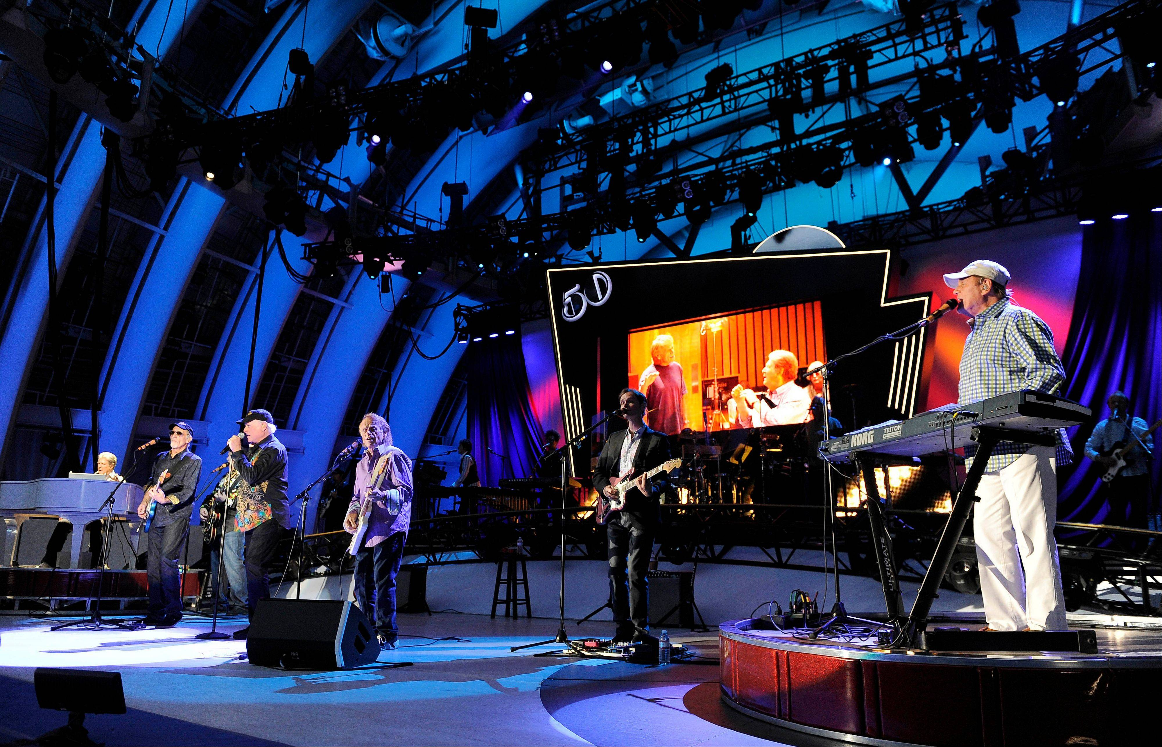 In this June 2, 2012 file photo, The Beach Boys perform at the Hollywood Bowl in Los Angeles. Brian Wilson says he felt blindsided by a news release from his Beach Boys bandmate Mike Love that ended the good vibrations on the band's 50th anniversary tour. Wilson says the expectation was that both sides would help craft and approve the news release. That didn't happen and now he thinks it's Love's turn to reach out.
