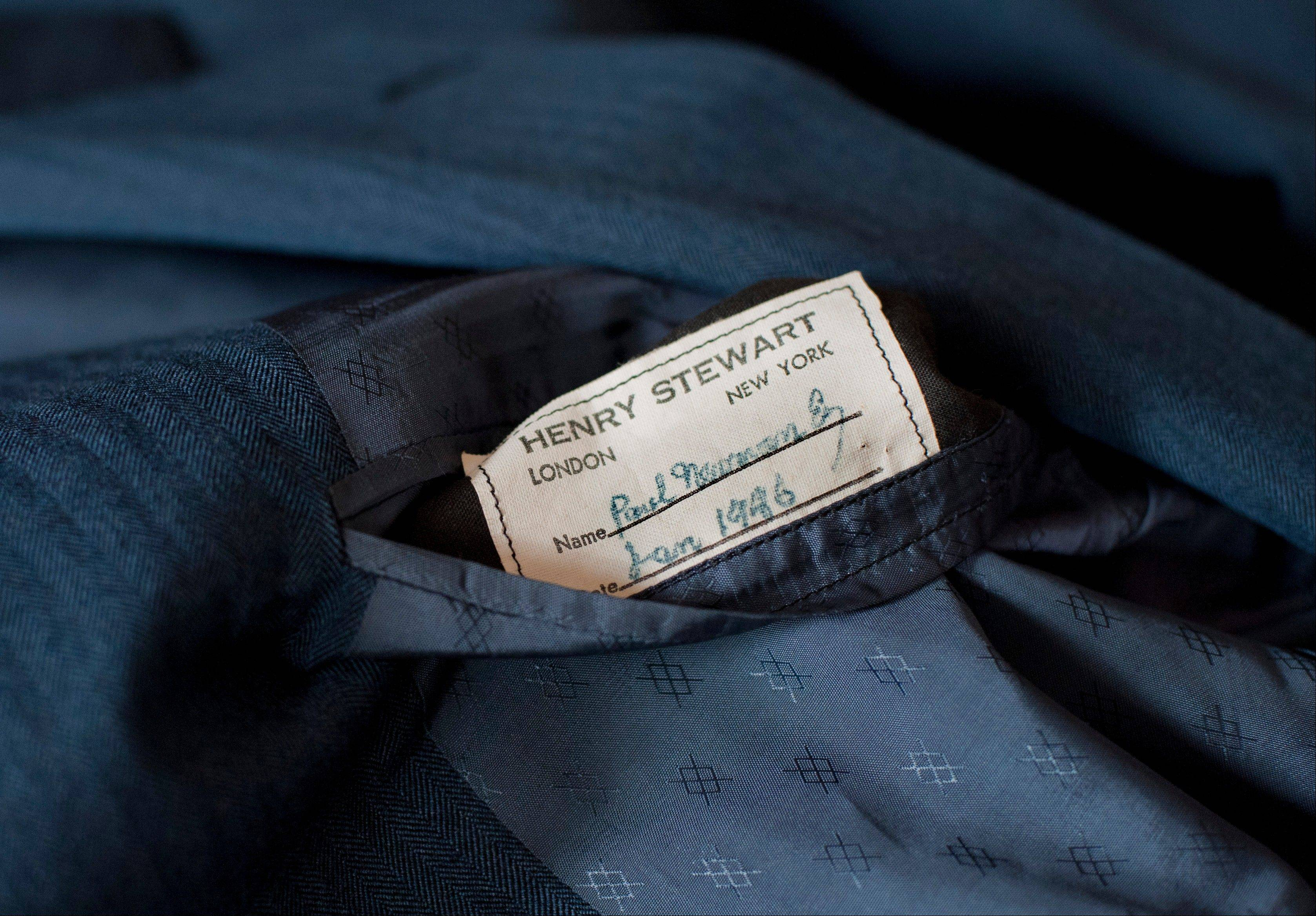 "A tailor's tag with the name ""Paul Newman"" is seen on a suit found by Peter Gamlen in the basement of his apartment in New Haven, Conn."