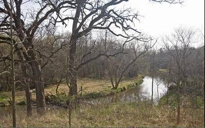 The 14-acre property includes a portion of Flint Creek.
