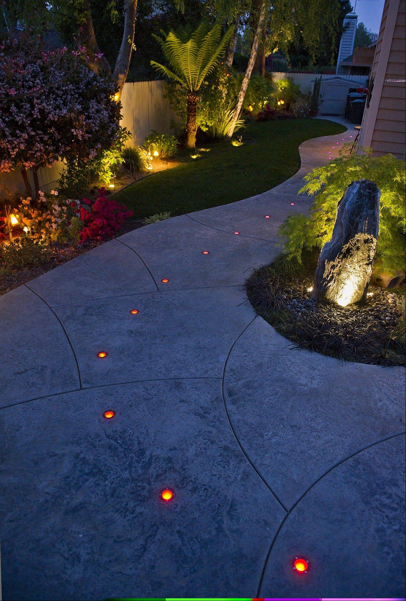 Color-changing LEDs mark a path through Michael Sestak's backyard. Other LEDs highlight plants and a granite fountain.