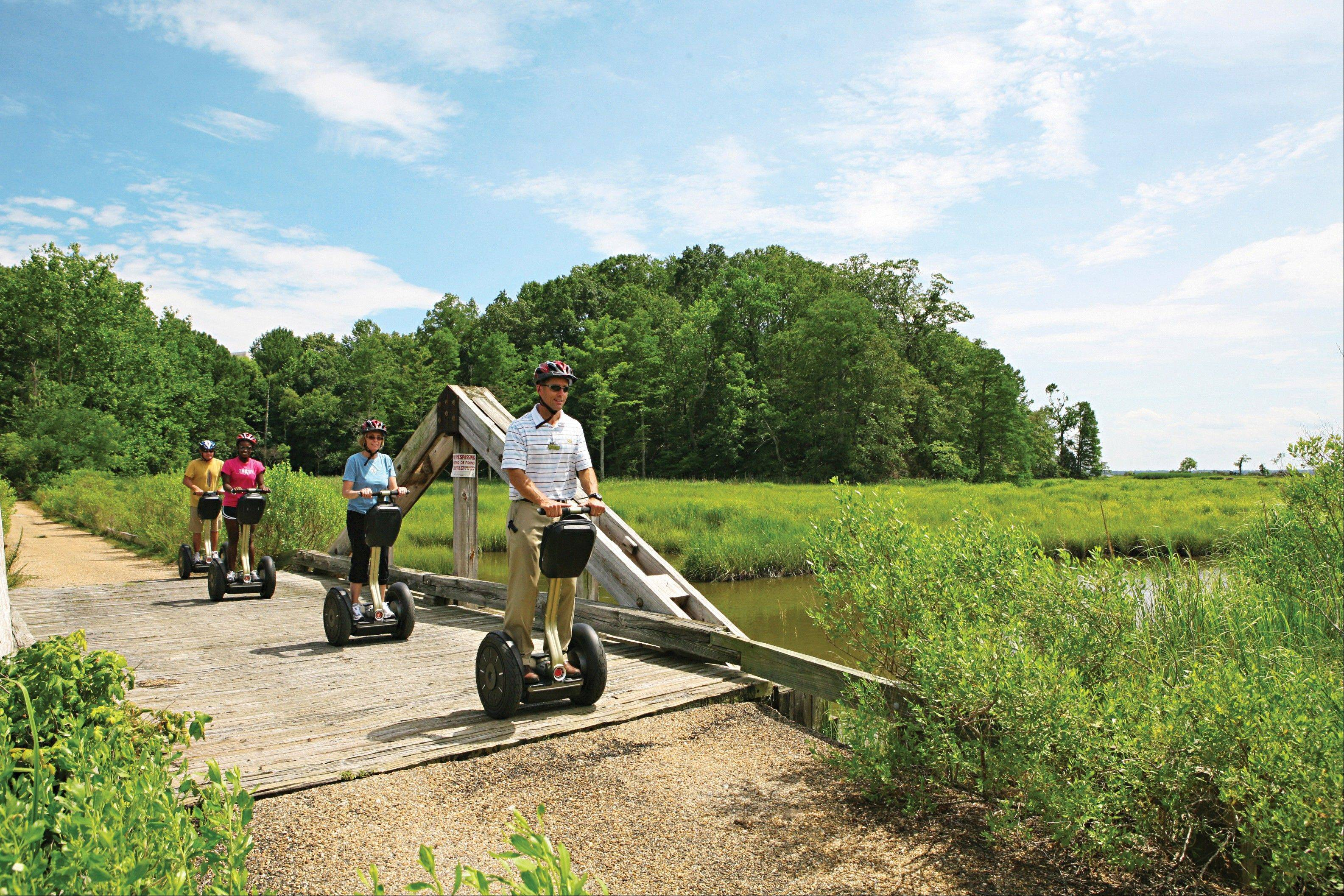 Kingsmill Resort's director of sports, Kevin Dry, leads a Segway tour on the resort's grounds in Williamsburg, Va.