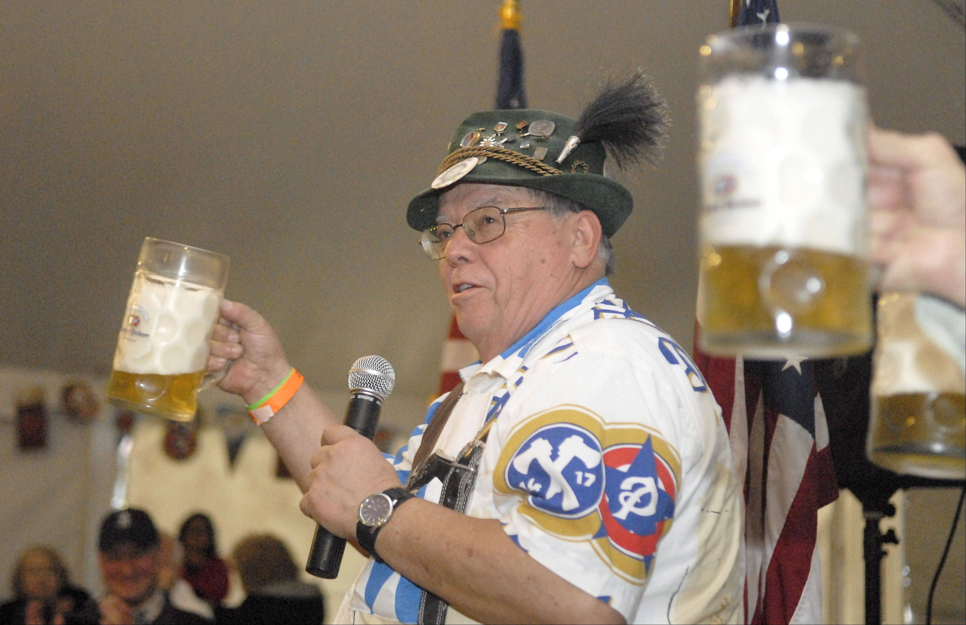 DANK Fox Valley President Willi Gohs holds up a stein of beer and toasts the crowd during the opening ceremony Saturday of the 10th annual Fox Valley Oktoberfest in downtown Batavia. A small barrel of beer flown directly from Germany was ceremonially tapped to officially start the celebration.