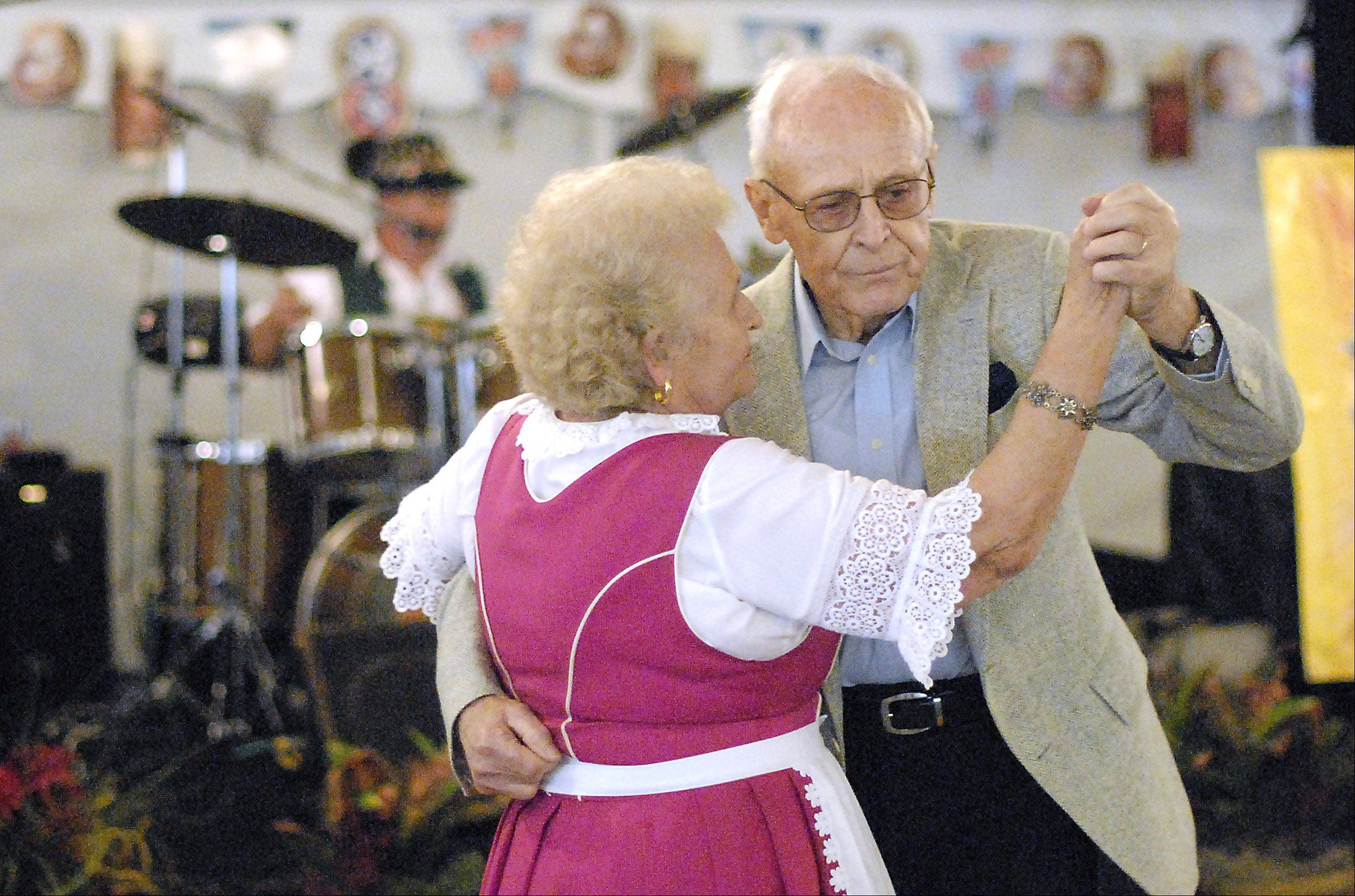 Hildegard and Frank Schreiber of Wheaton dance to the music of German band Die Perlen during the 10th annual Fox Valley Oktoberfest on Saturday in downtown Batavia. The couple has attended the festival every year since it started.