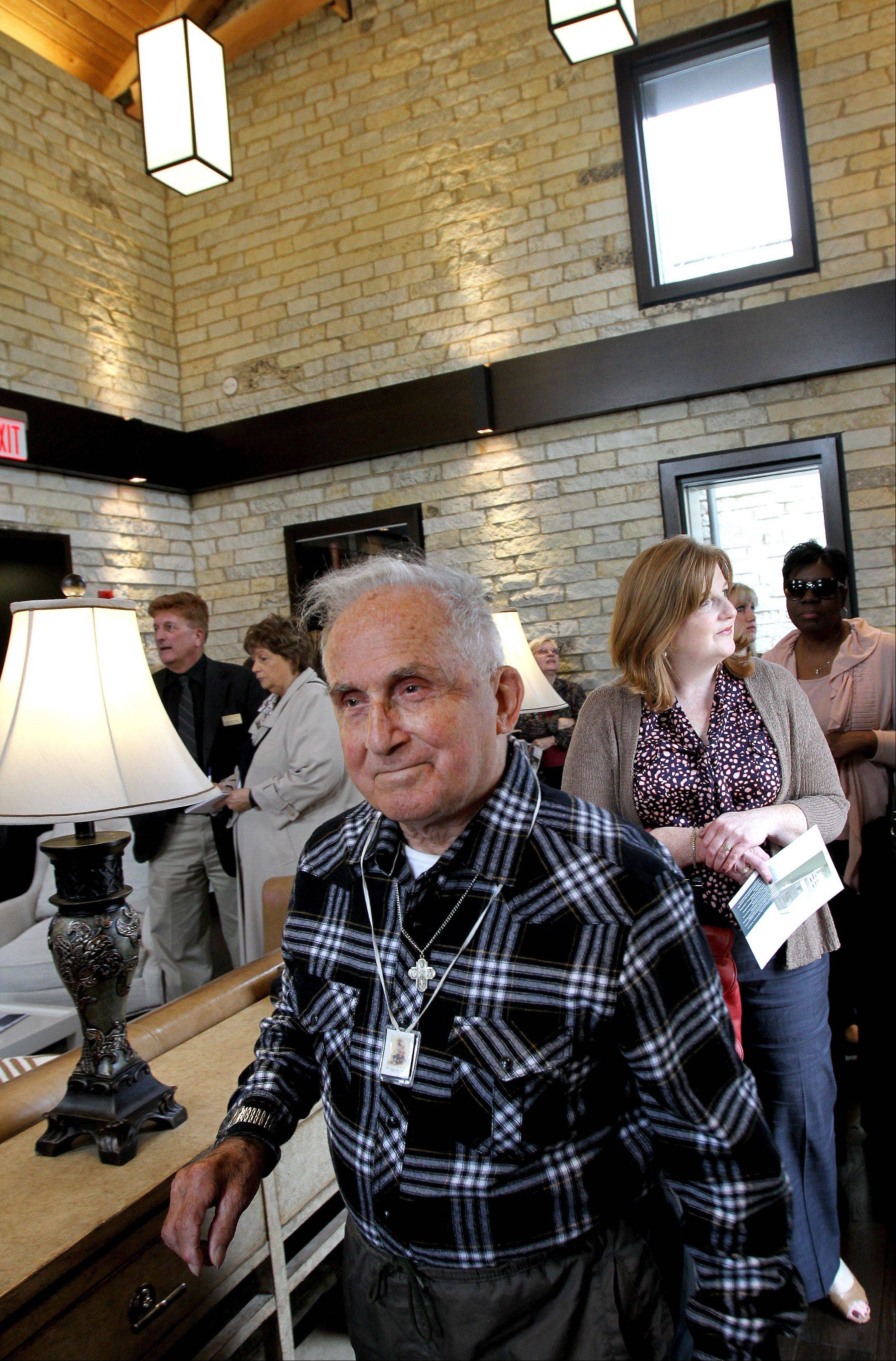 Arthur Denardo takes a look at the unveiling of the Neff Welcome Center at Benedictine University in Lisle. Denardo was the last resident of the historic Neff farmhouse and lived there for 48 years. He now lives at Benedictine Abbey.