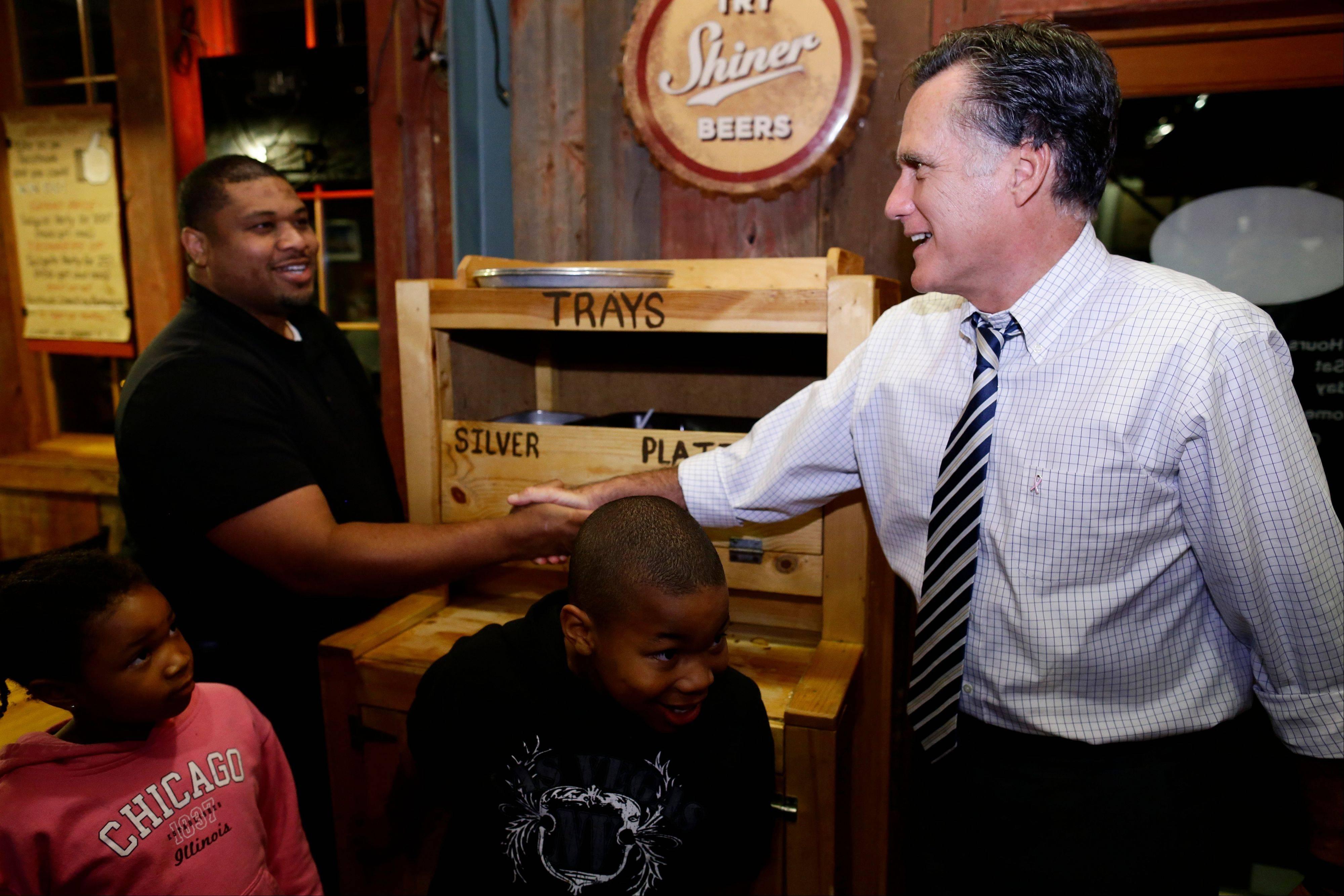 Republican presidential candidate and former Massachusetts Gov. Mitt Romney greets customers Friday as he makes an unscheduled stop at City Barbeque in Gahanna, Ohio.