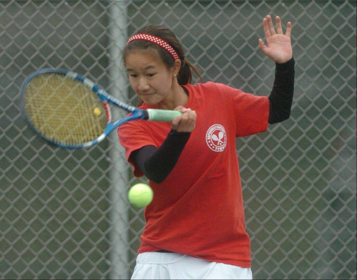 Tiffany Chen of Naperville Central takes part in the Naperville North girls tennis sectional at Naperville North High School Saturday.