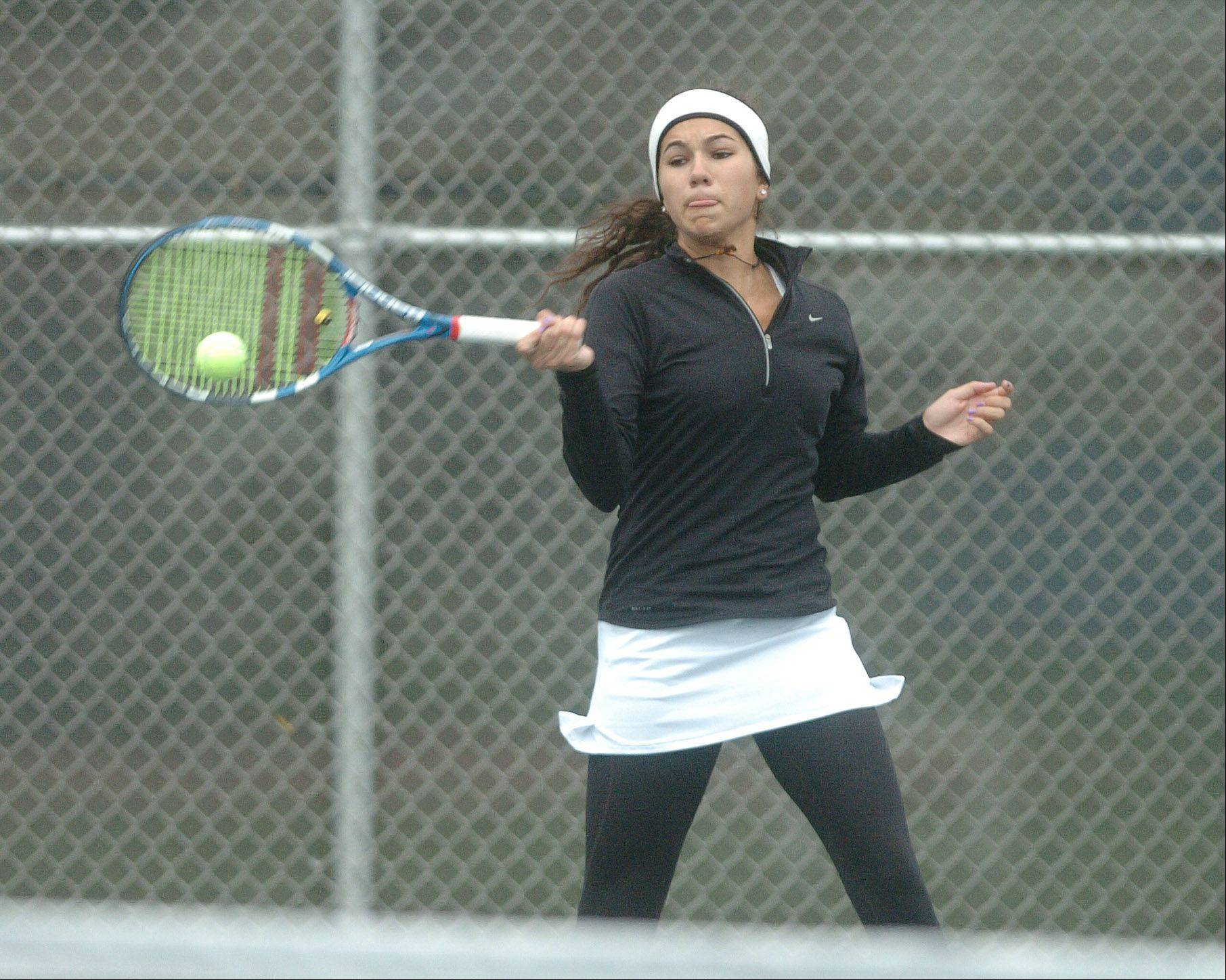 Leah Tzakis of Benet takes part in the Naperville North girls tennis sectional at Naperville North High School Saturday.