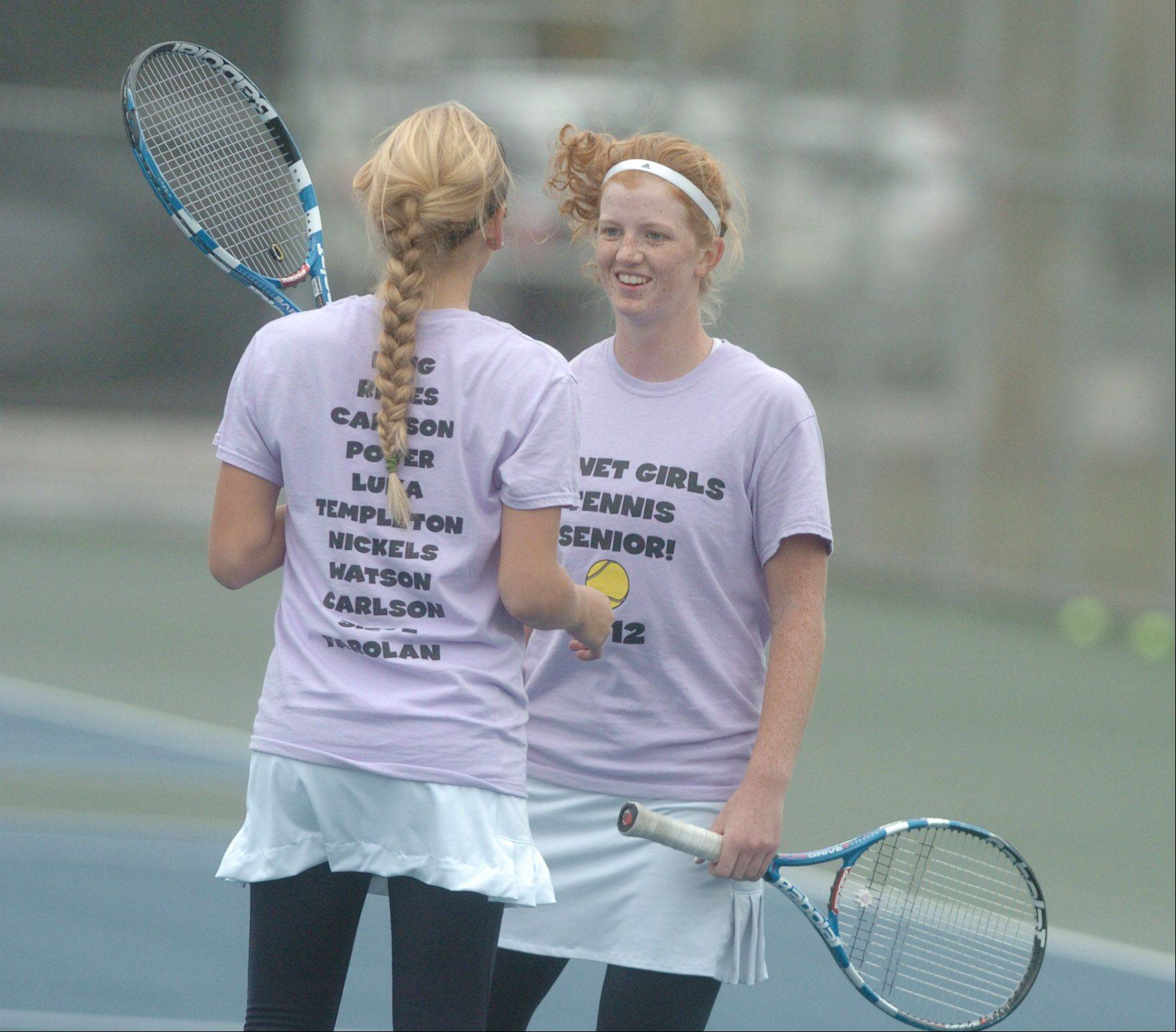 Daniella Reyes,left, and Mary Beth King of Benet are all smiles during the Naperville North girls tennis sectional at Naperville North High School Saturday. They are doubles team mates. They were leading in their match against Naperville North.