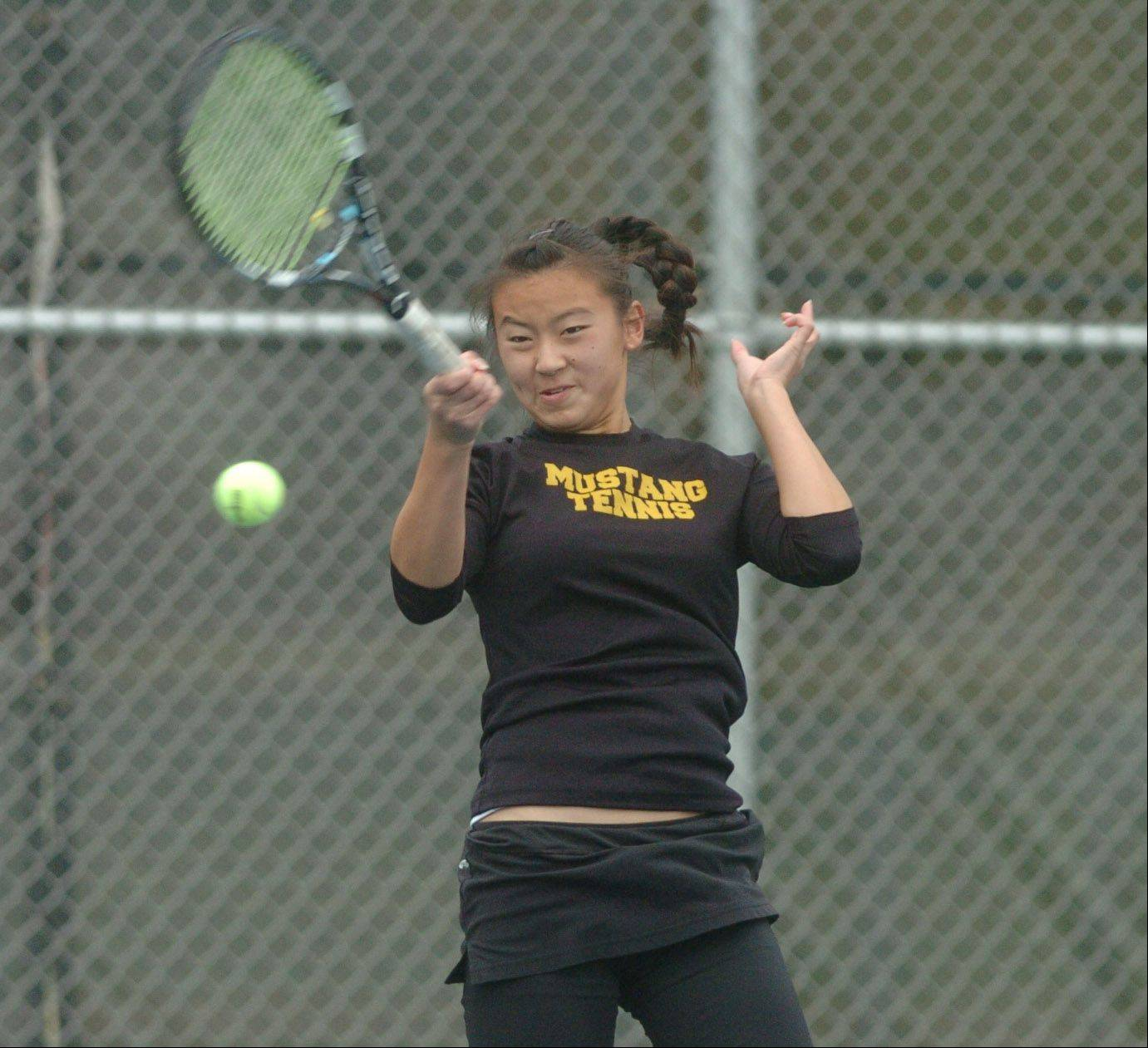 Kelsey Chin of Metea Valley takes part in the Naperville North girls tennis sectional at Naperville North High School Saturday.