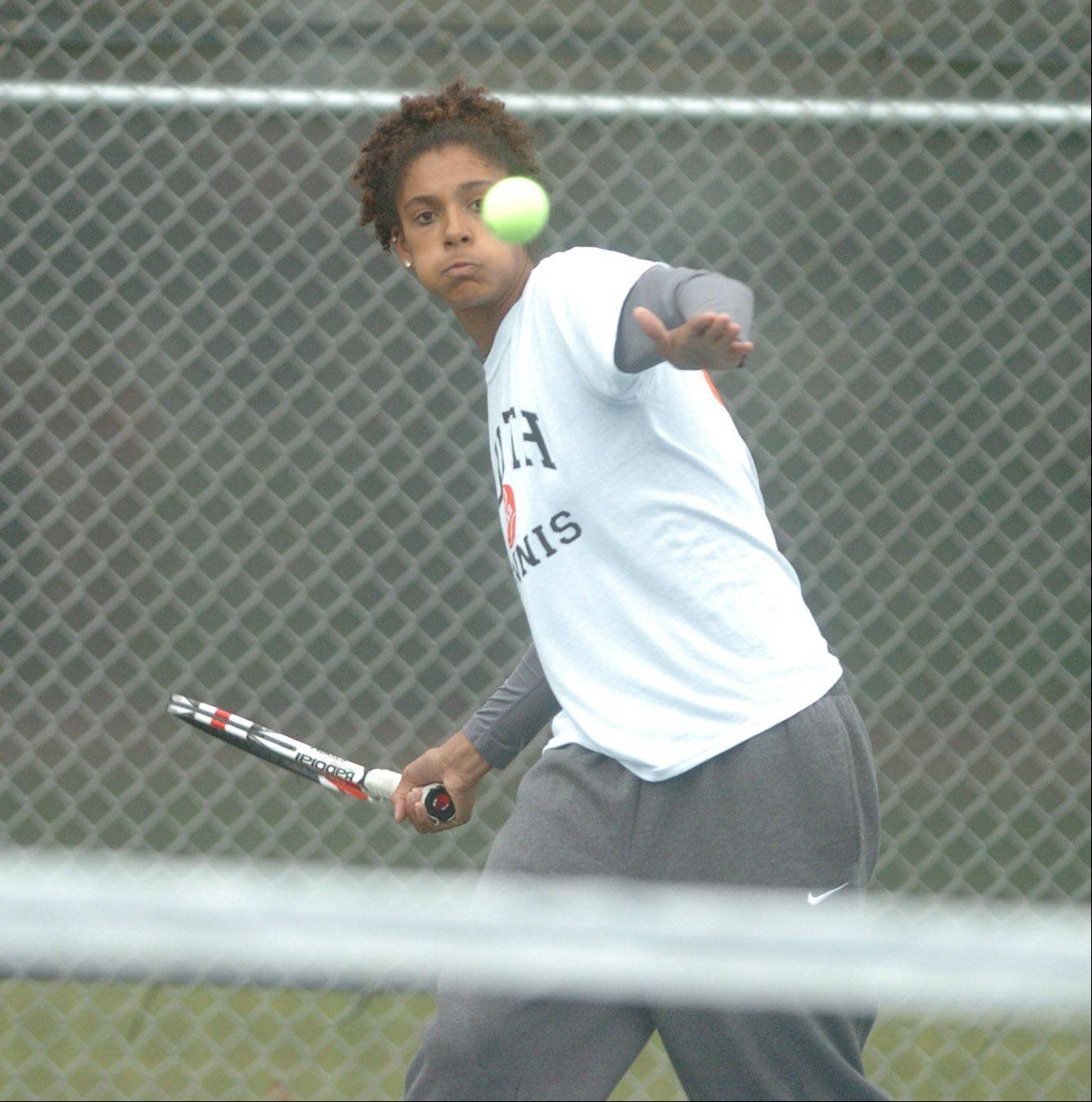 Keisha Clousing of Wheaton Warrenville South takes part in the Naperville North girls tennis sectional at Naperville North High School Saturday.