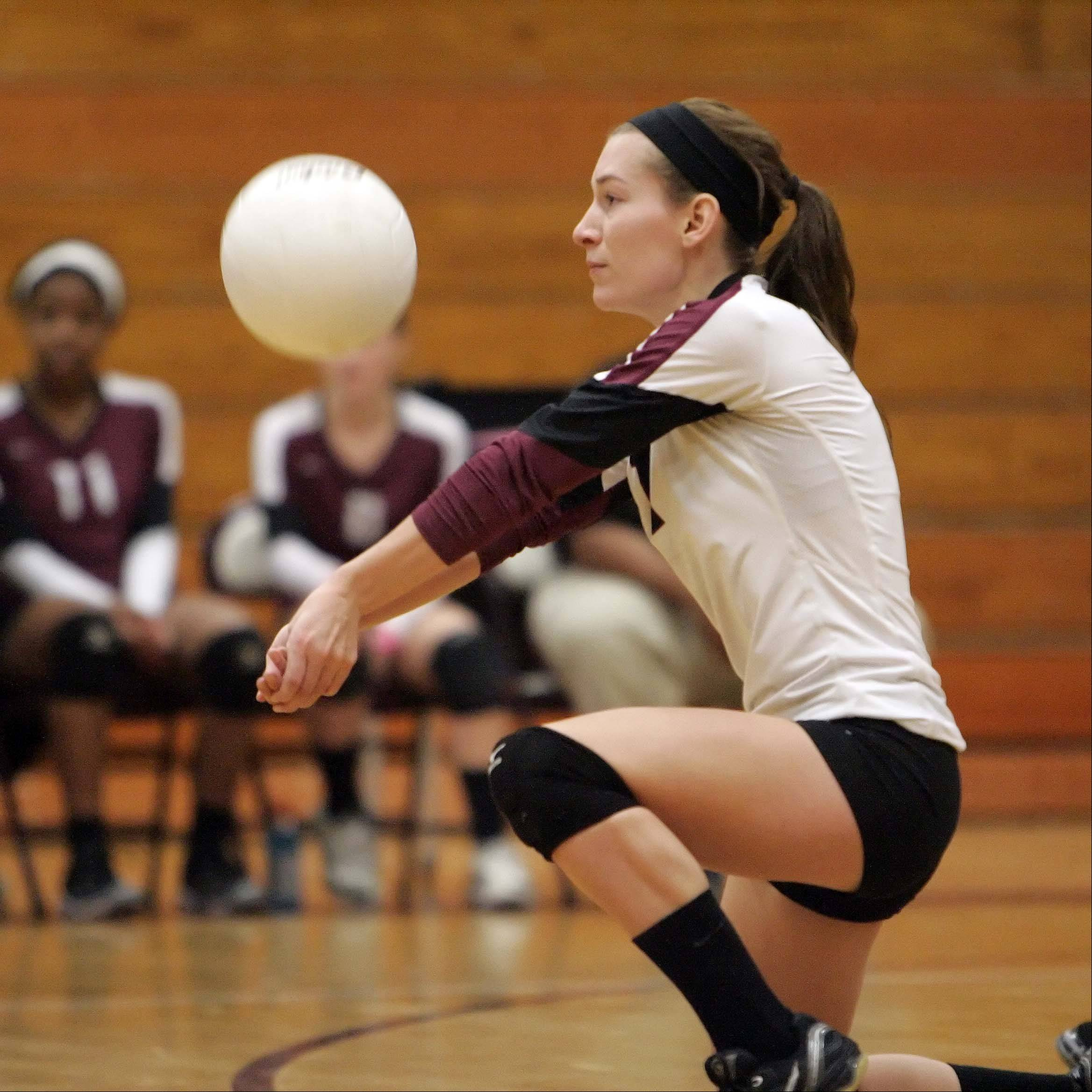 Elgin's Taylor Powers pulls out a dig against Rolling Meadows during the Elgin High School Lady Maroons 22nd annual varsity invitational volleyball tournament Saturday at Chesbrough Field House.
