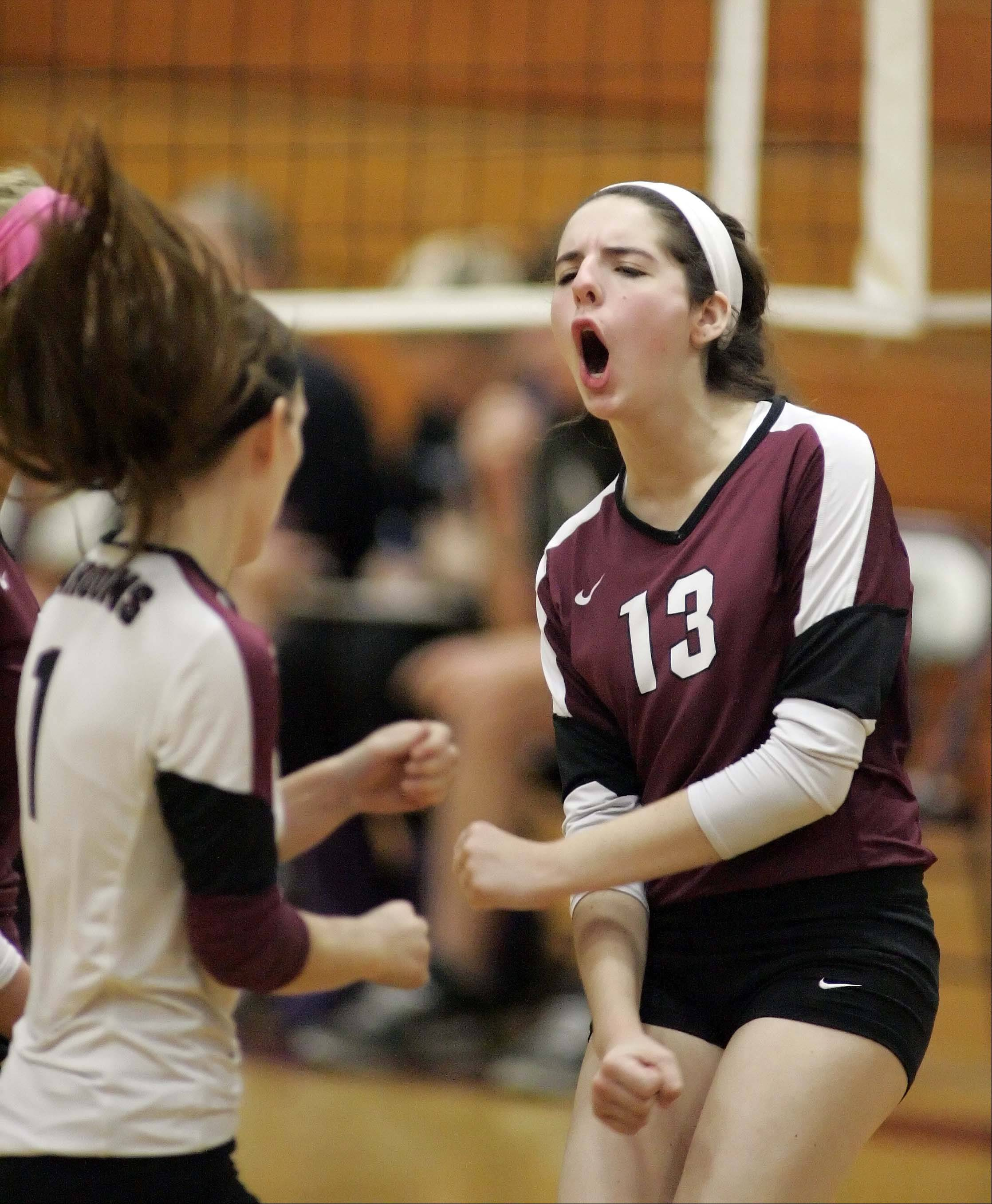 Elgin's Sarah Kish celebrates a point against Rolling Meadows during the Elgin High School Lady Maroons 22nd annual varsity invitational volleyball tournament Saturday at Chesbrough Field House.