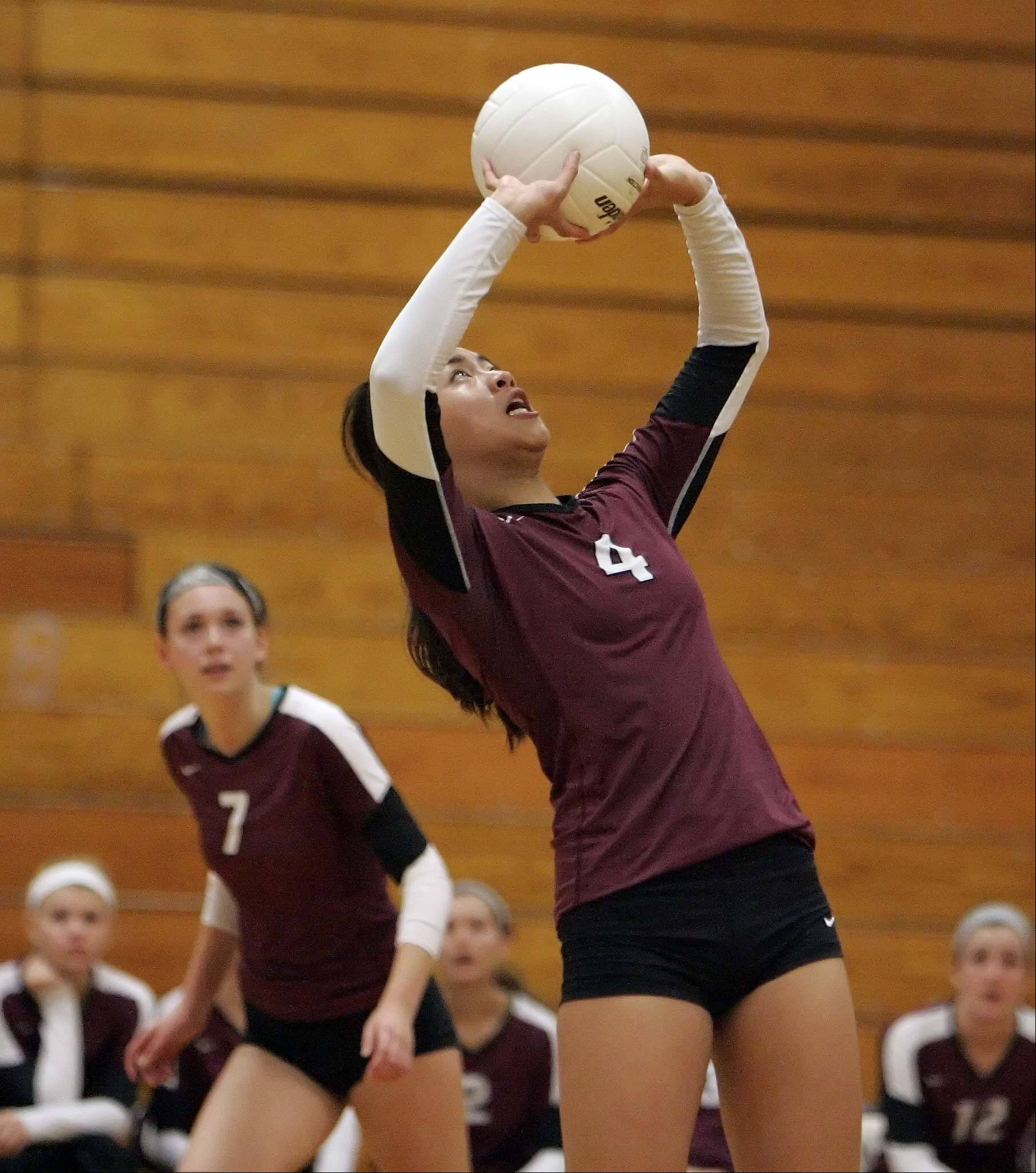 Elgin's Kristin Tayag sets up a pass to Hope Demel against Rolling Meadows during the Elgin High School Lady Maroons 22nd annual varsity invitational volleyball tournament Saturday at Chesbrough Field House.