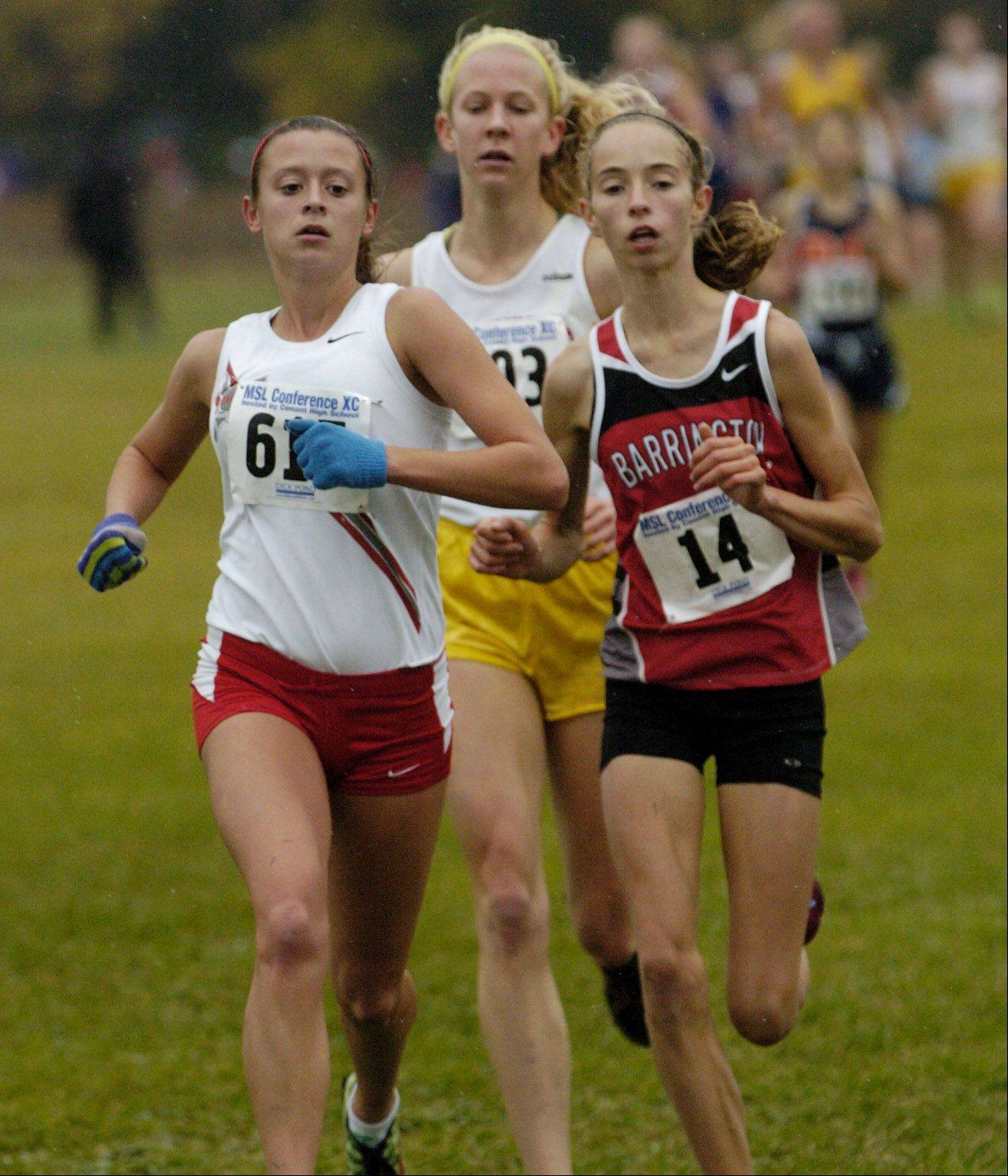 Palatine's Tess Wasowicz leads Lauren Conroy of Barrington, right, and Caroline Kurdej of Schaumburg after first lap of girls varsity Mid-Suburban League cross country championship at Busse Woods.