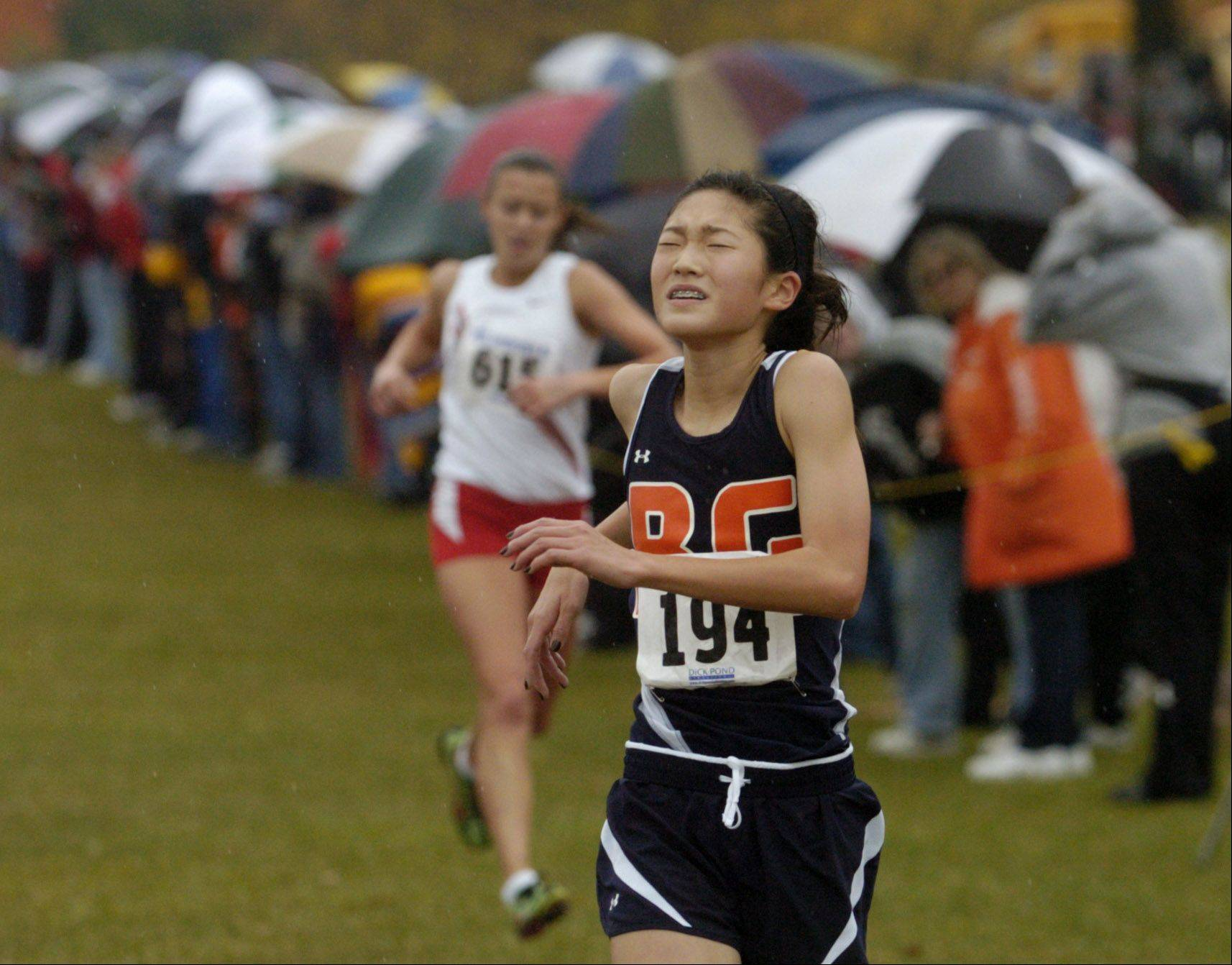 Kaitlyn Ko of Buffalo Grove takes third place, just ahead of Palatine's Tess Wasowicz, in the Mid-Suburban League girls cross country championship.