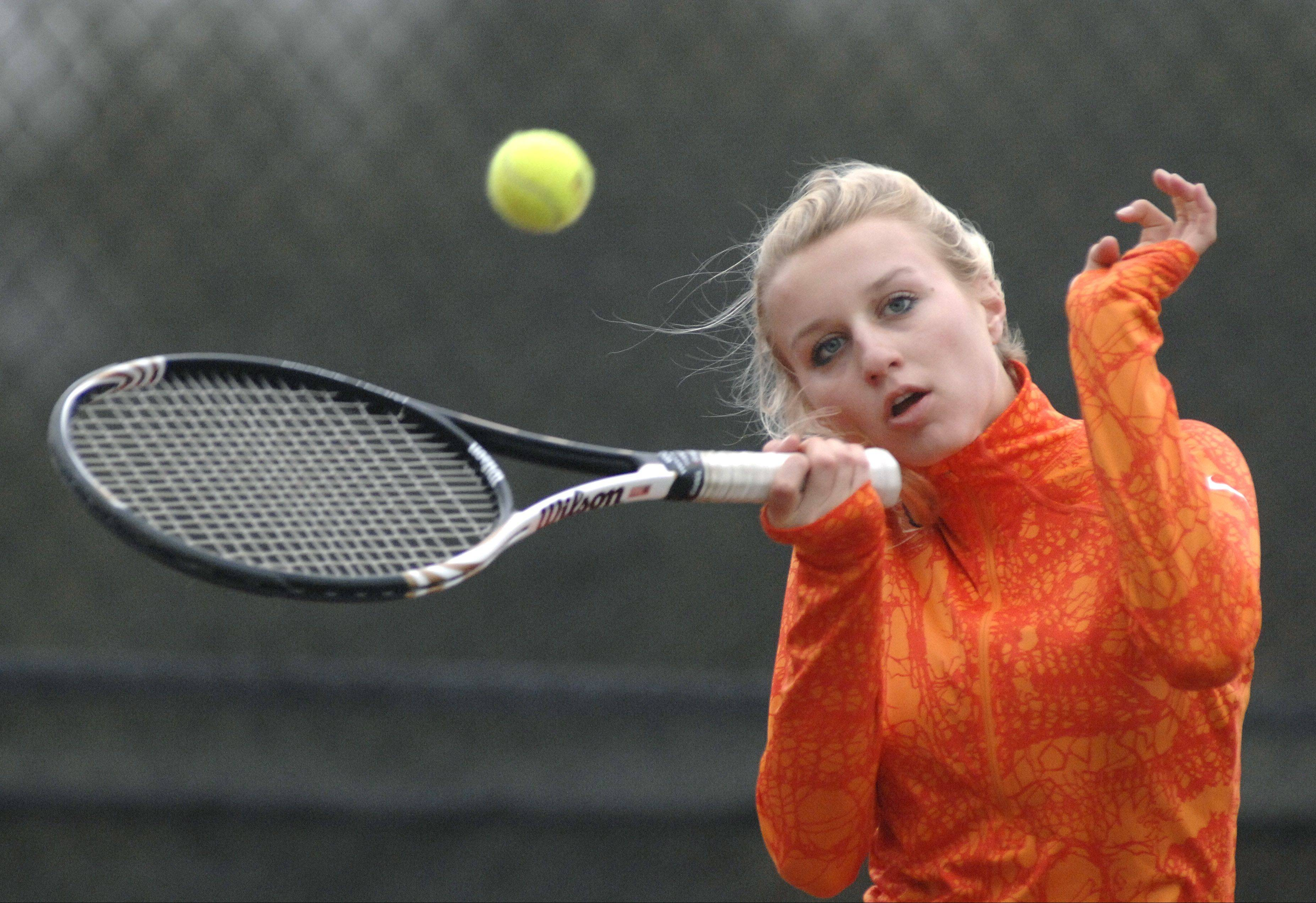 St. Charles East's Sarah Church in a singles semi-finals match in the sectional at St. Charles East on Saturday, October 13.