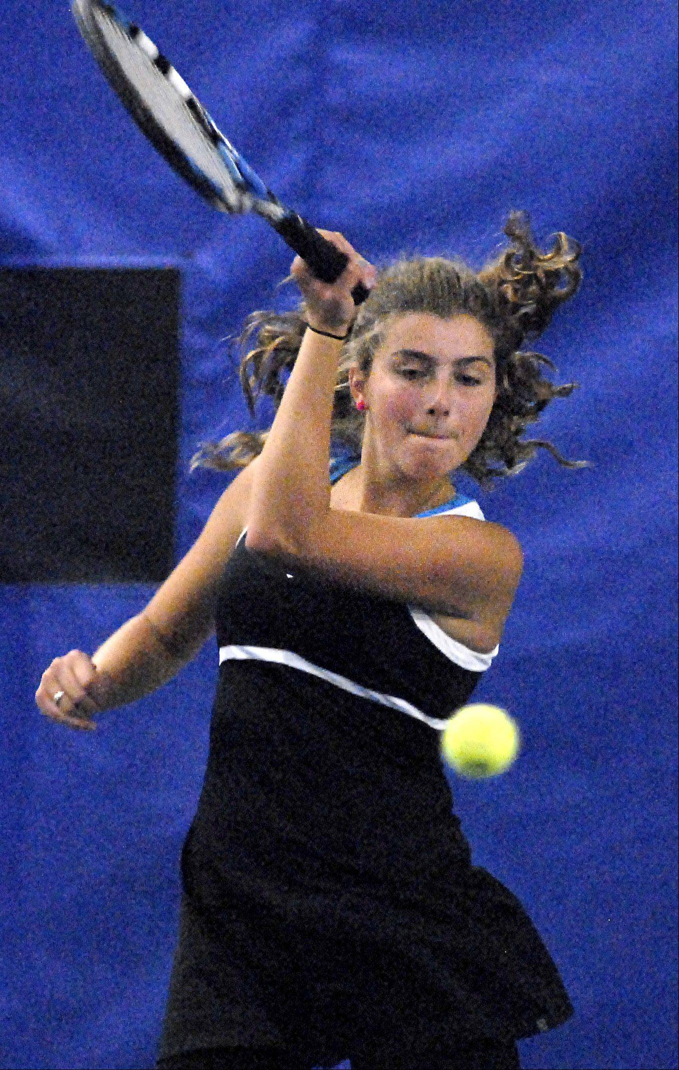 St. Charles East's Haydyn Jones fires a forehand Saturday.