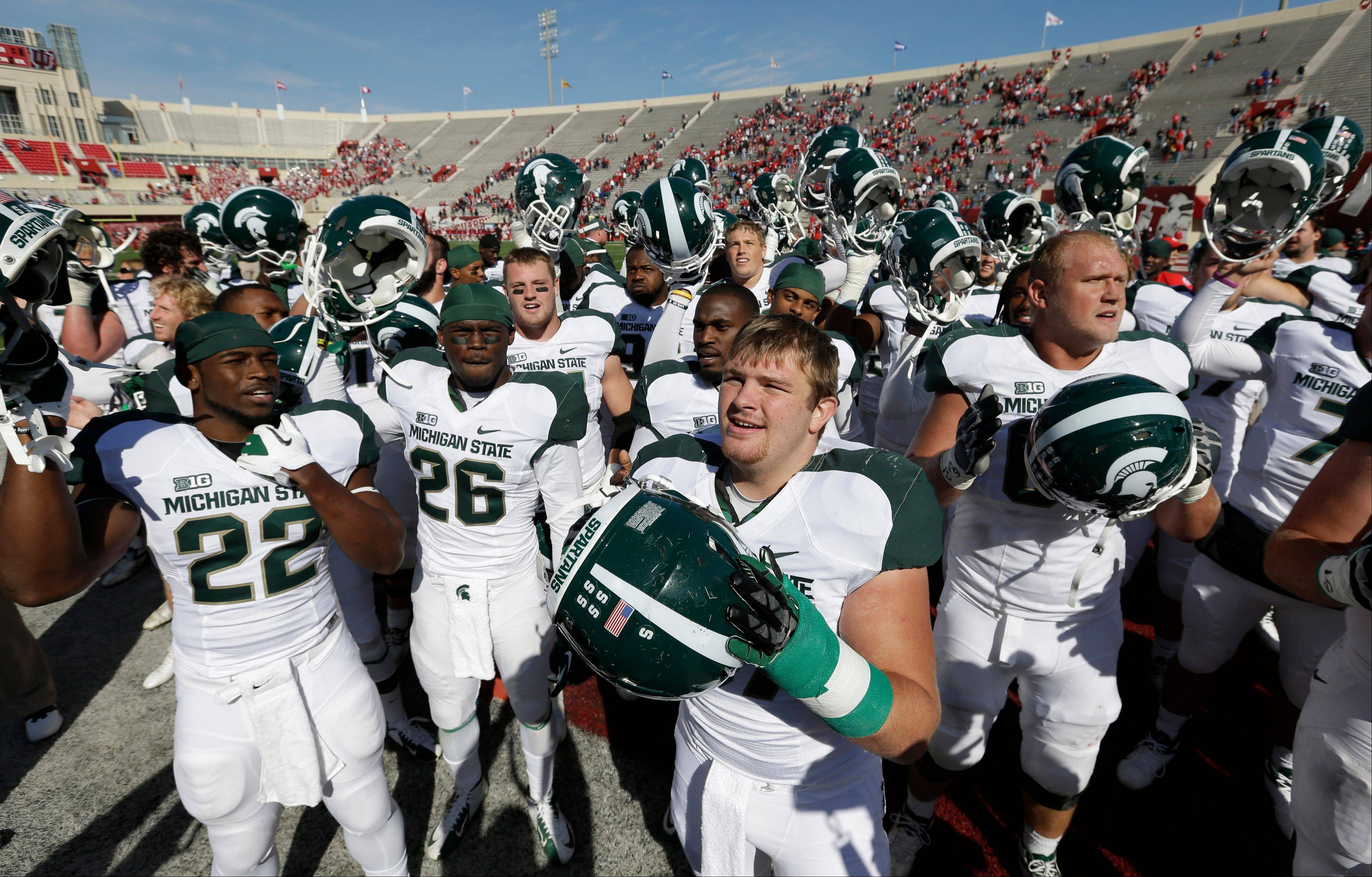 Michigan State fullback Trevon Pendleton, front, and teammates celebrate after the Spartans defeated Indiana 31-27 last Saturday in Bloomington, Ind.