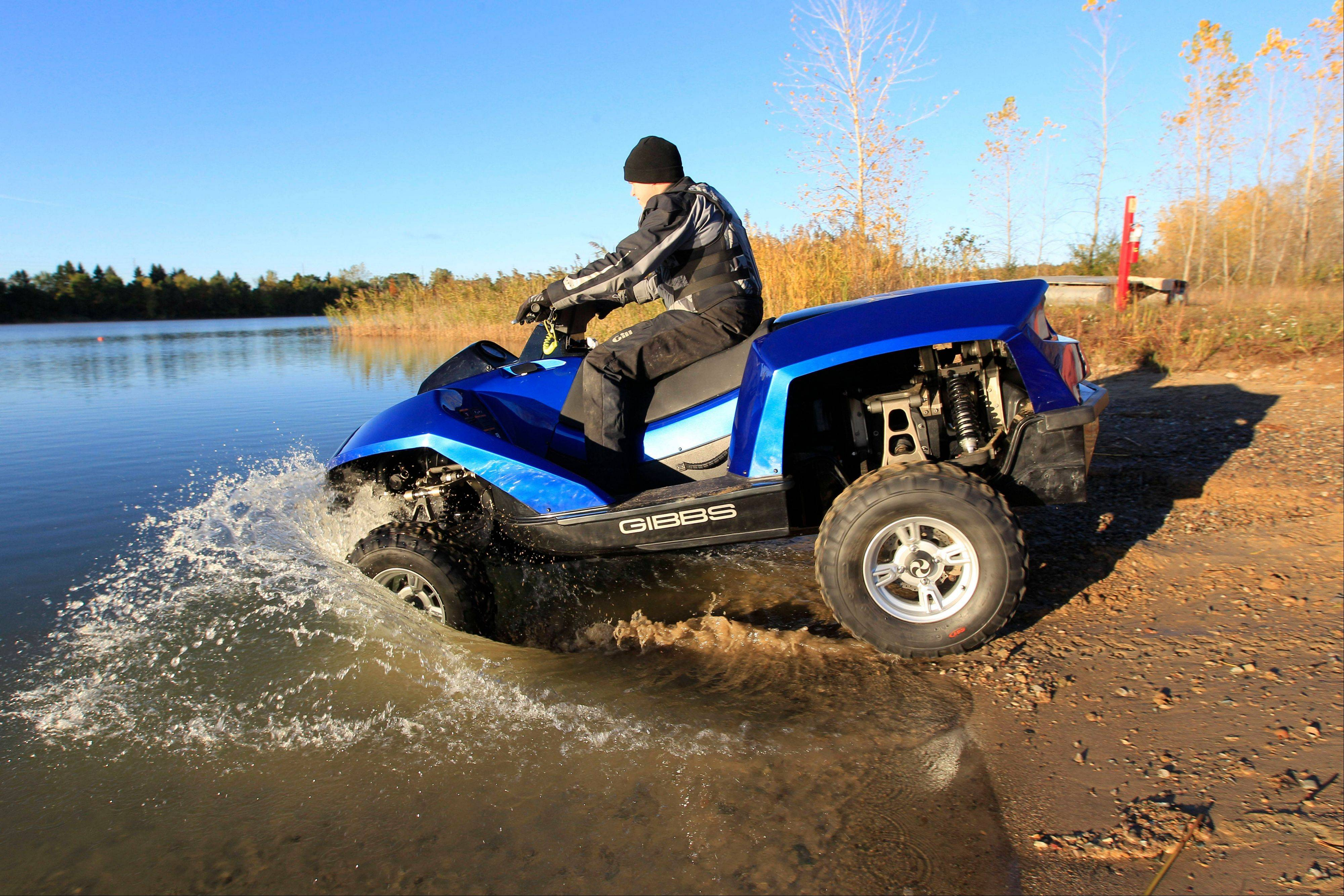 The Quadski, a one-person motor boat that also drives on land, is tested in Oxford Mich. The vehicle is being billed as the first commercially available, high-speed amphibious vehicle by its makers, Michigan-based Gibbs Technologies.
