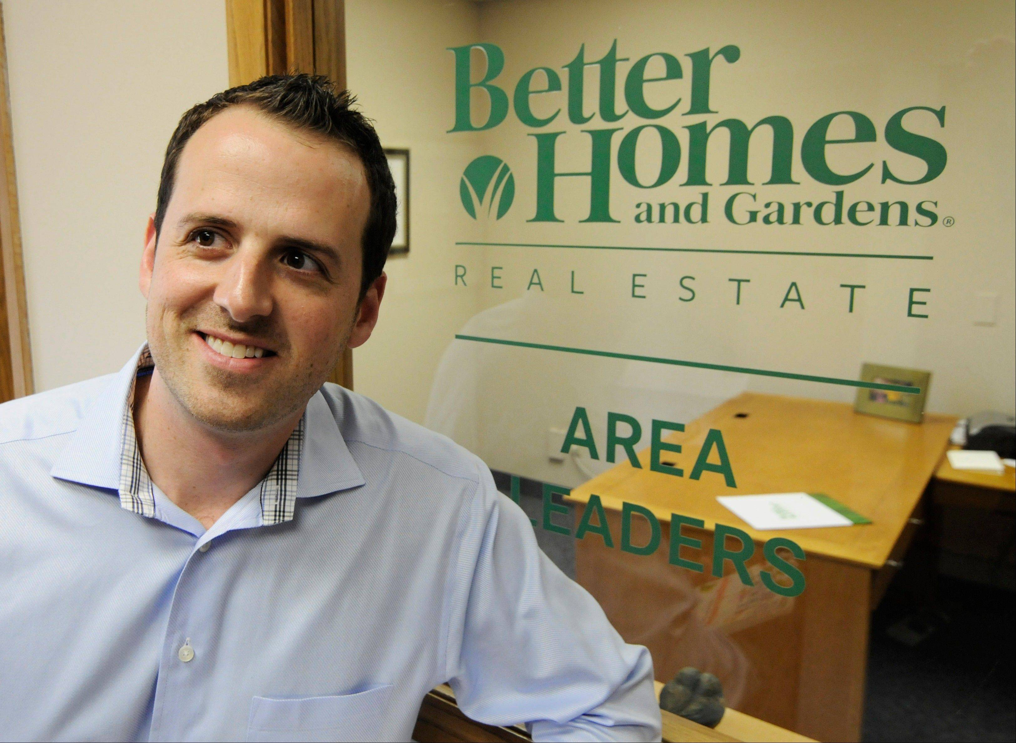 Andy Asbury, owner of Better Homes & Gardens Real Estate Area Lenders, is shown at his office in Edina, Minn. Asbury, who has the business to support more agents, hired a full-time employee just last Friday. Asbury said his sales are up 25 percent from a year ago and he�s expecting them to rise further next year.