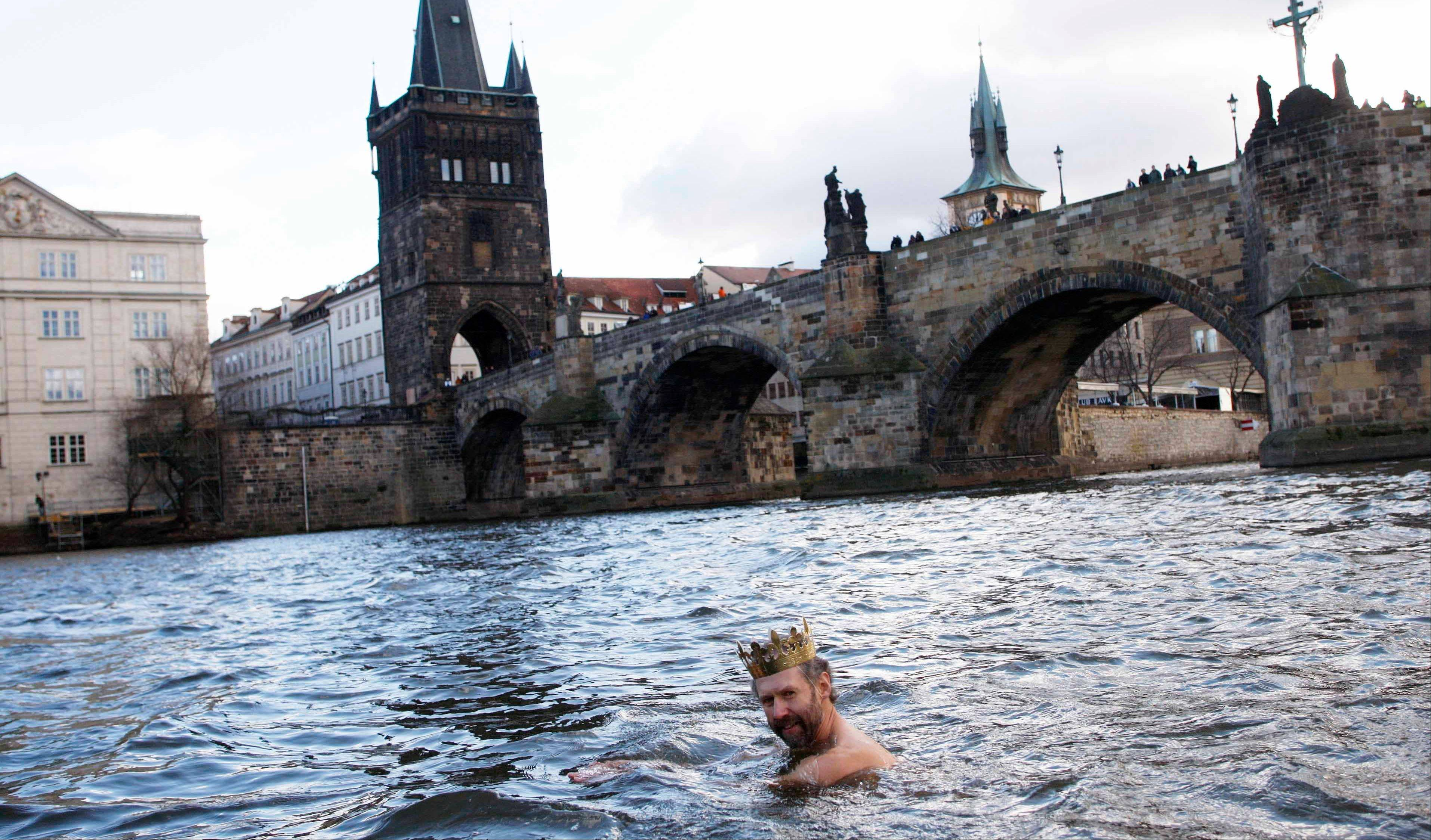 A polar swimmer takes part in the new year swim in the Vltava river in front of the Charles Bridge in Prague.