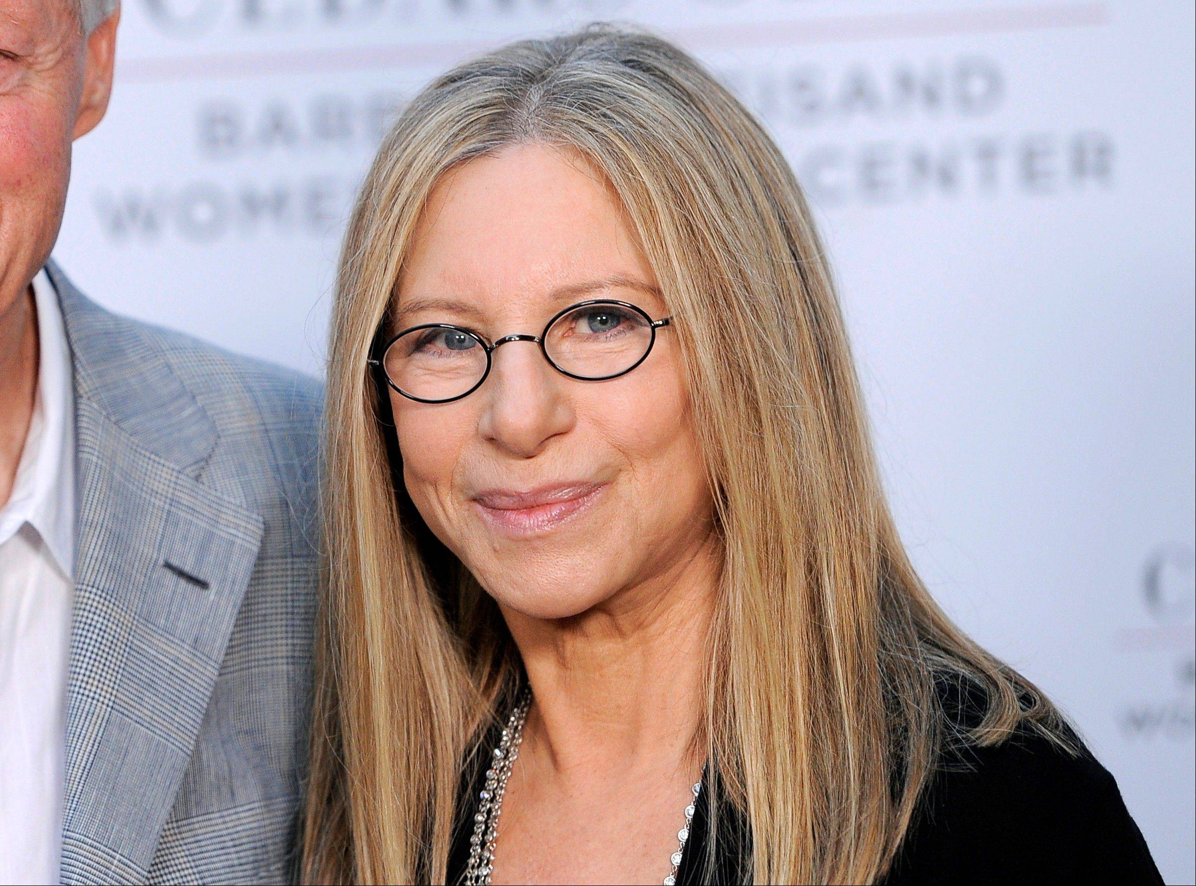 "In this June 14, 2012 file photo, Barbra Streisand arrives at the dedication of the Barbra Streisand Women's Heart Center in the Cedars-Sinai Heart Institute at her home in Malibu, Calif. Streisand's latest album, ""Release Me,"" is a collection of songs she recorded in the 1960s, '70s and '80s."